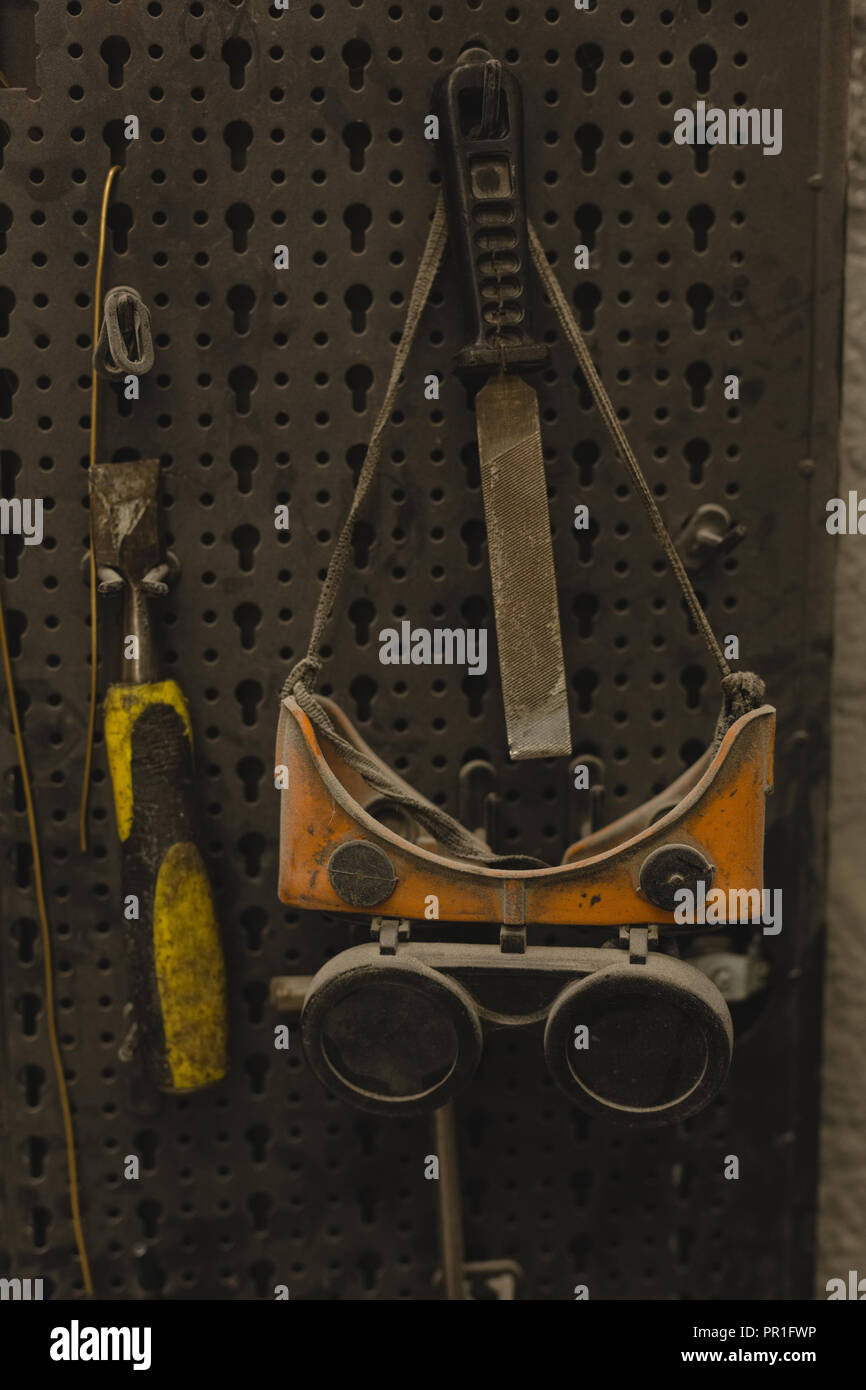 Protective eyewear and tool in garage - Stock Image