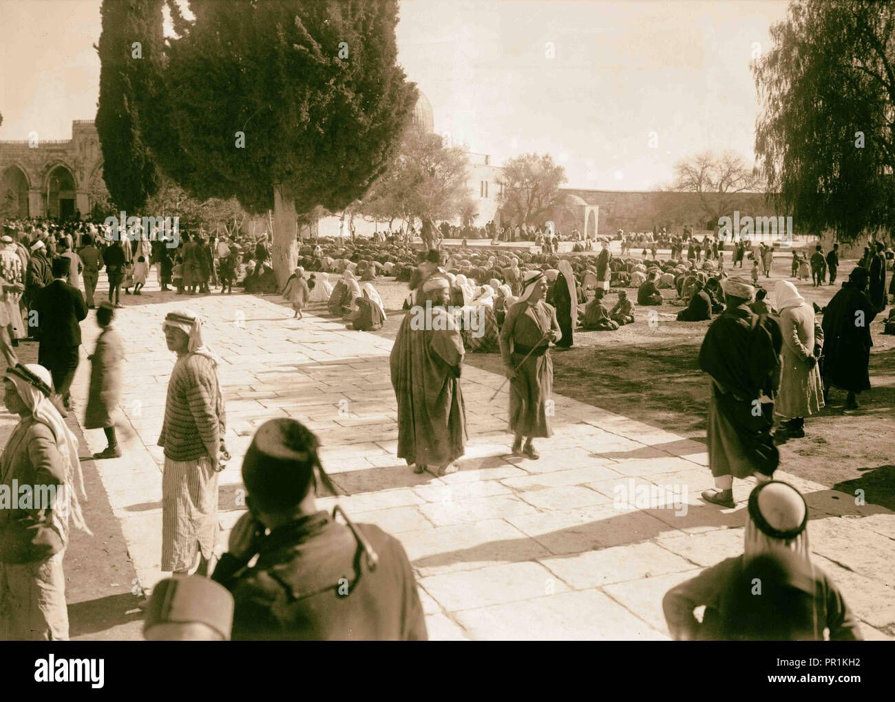 Moslems, Muslims at prayer in mosque (Dome of the Rock) grounds, at time of Mohamed Ali's funeral. 1931, Jerusalem, Israel - Stock Image