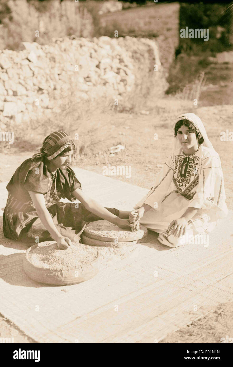 Arab women working primitive grain mill 1898, Middle East, Israel and/or Palestine - Stock Image