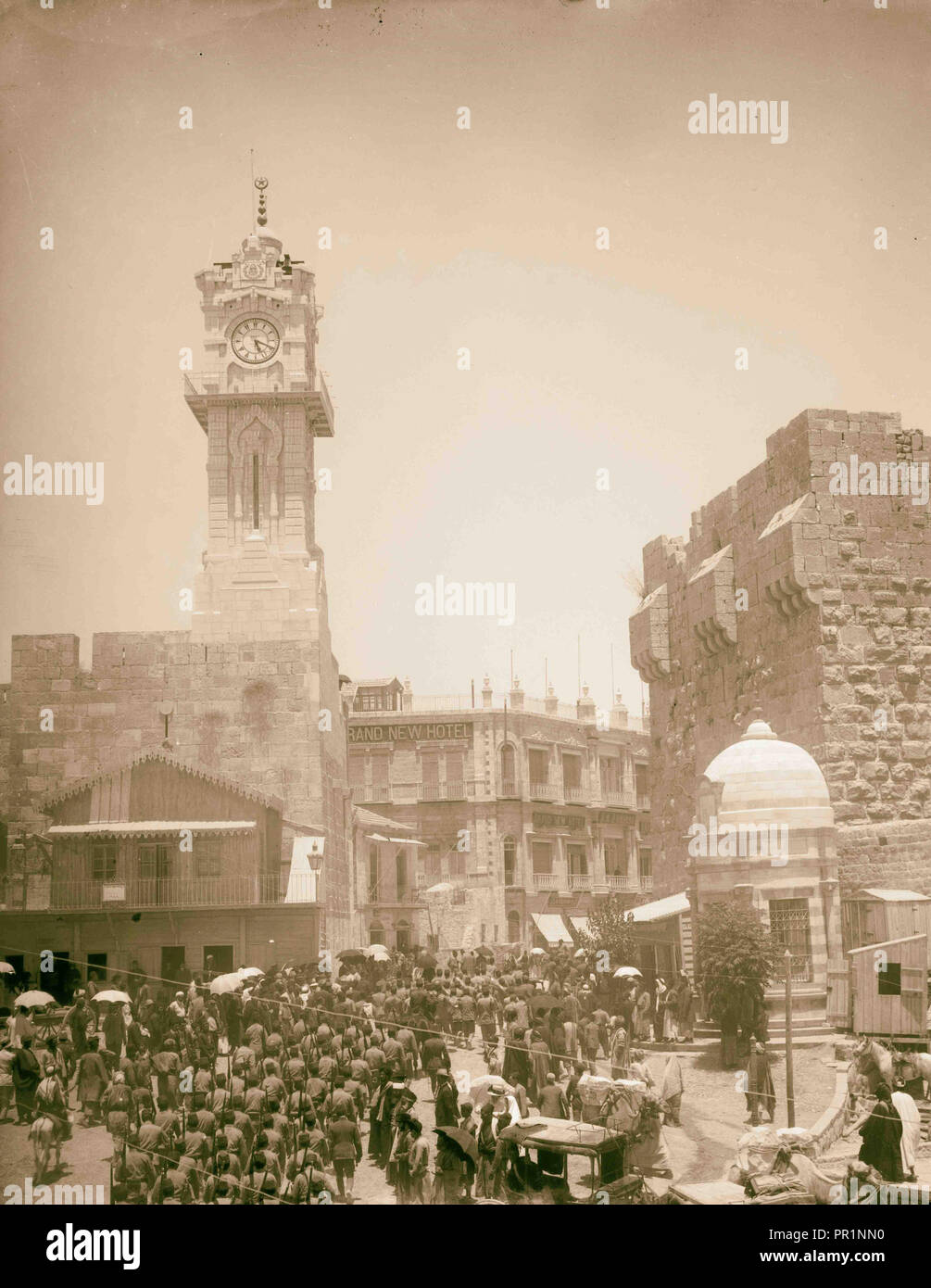 Marching in front of American Colony store. Grand New Hotel, Jerusalem 1907 Israel Stock Photo