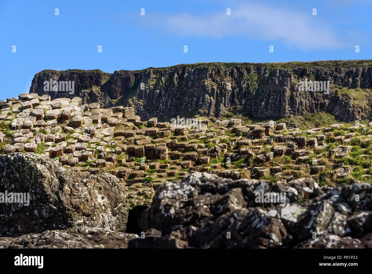 Giants Causeway, in Northern Ireland, a coastline filled with natural interlocking basalt columns, the remnants from an ancient volcanic fissure erupt - Stock Image