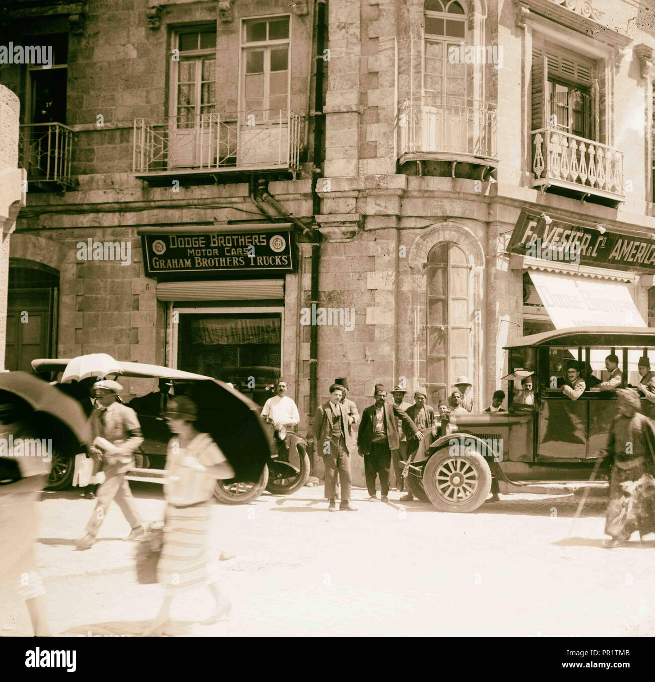 Corner of Grand Hotel showing American Colony stores and Dodge auto business (one of Am. Colony enterprises). 1920, Jerusalem Stock Photo