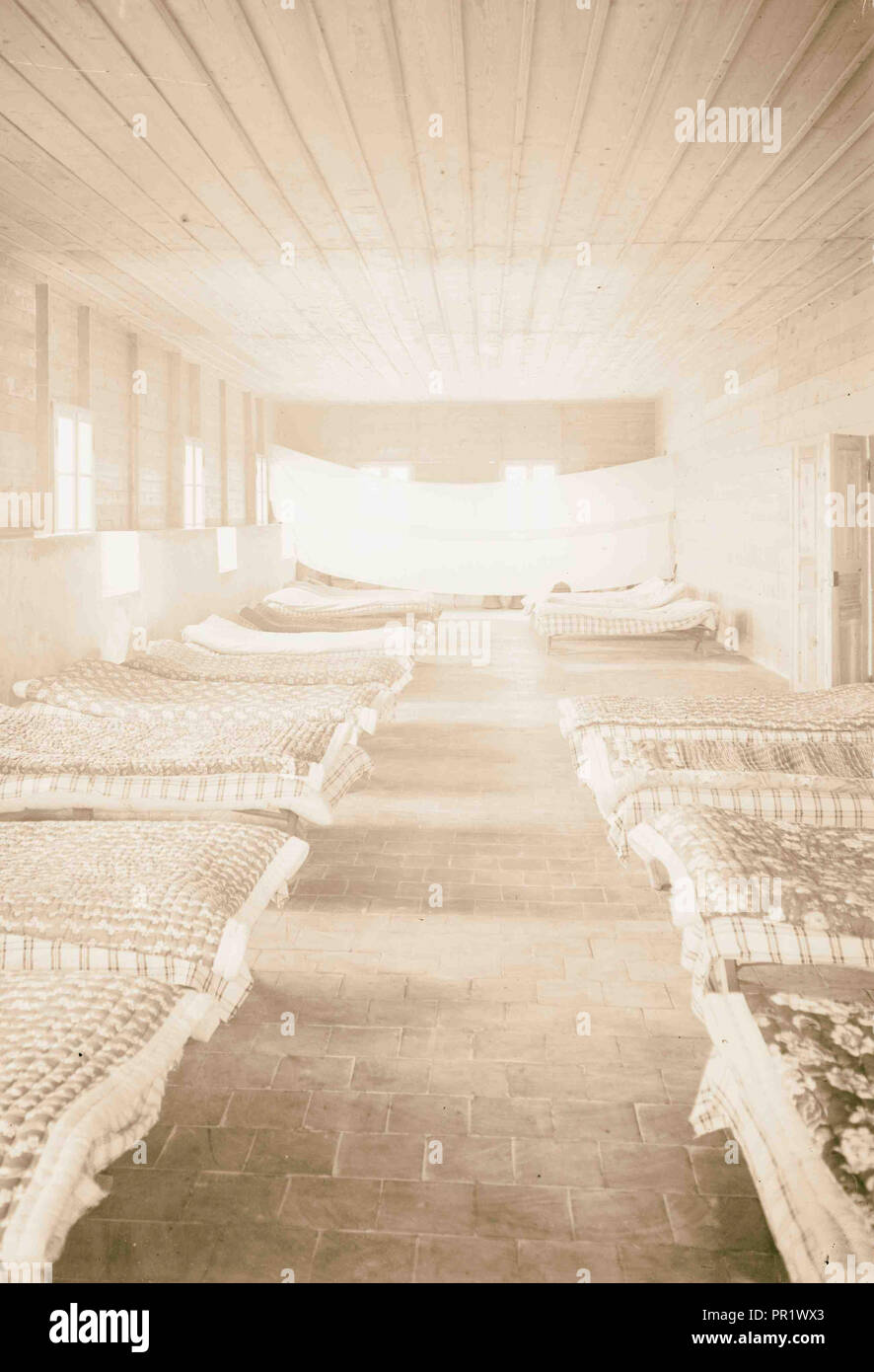 People next to buildings (left); mattresses on floor (right). 1898, Middle East, Israel and/or Palestine - Stock Image
