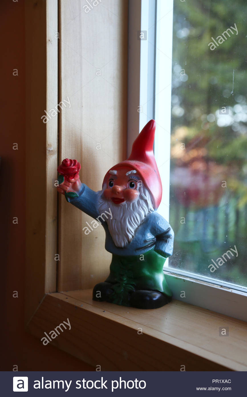Colourful retro garden gnome. - Stock Image