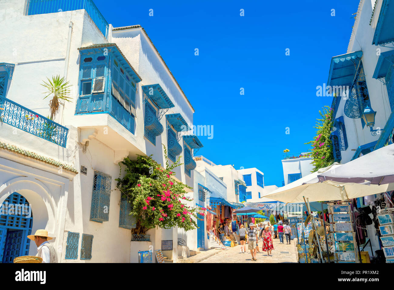 Main shopping street  in white blue town Sidi Bou Said. Tunisia, North Africa - Stock Image