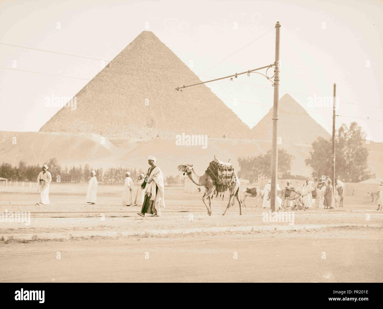 Pyramids of Gizeh. Two great pyramids from end of train line. 1934, Egypt, Jīzah, Jizah - Stock Image