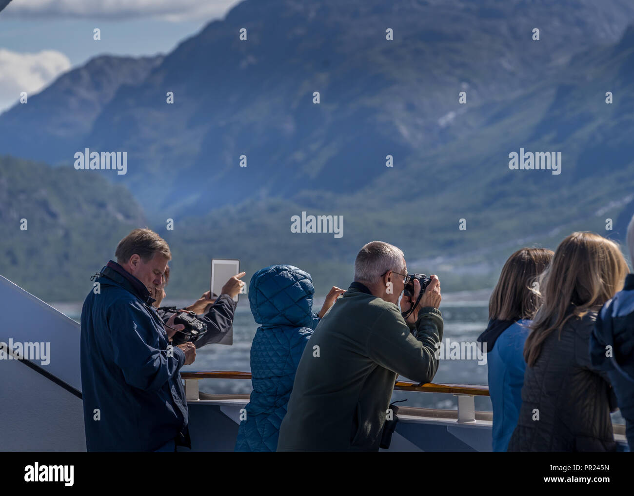 Glacier Bay Alaska USA.  Aug 17, 2018 - People get ready to take photos when the cruise ship approching to the Glacier Bay - Stock Image