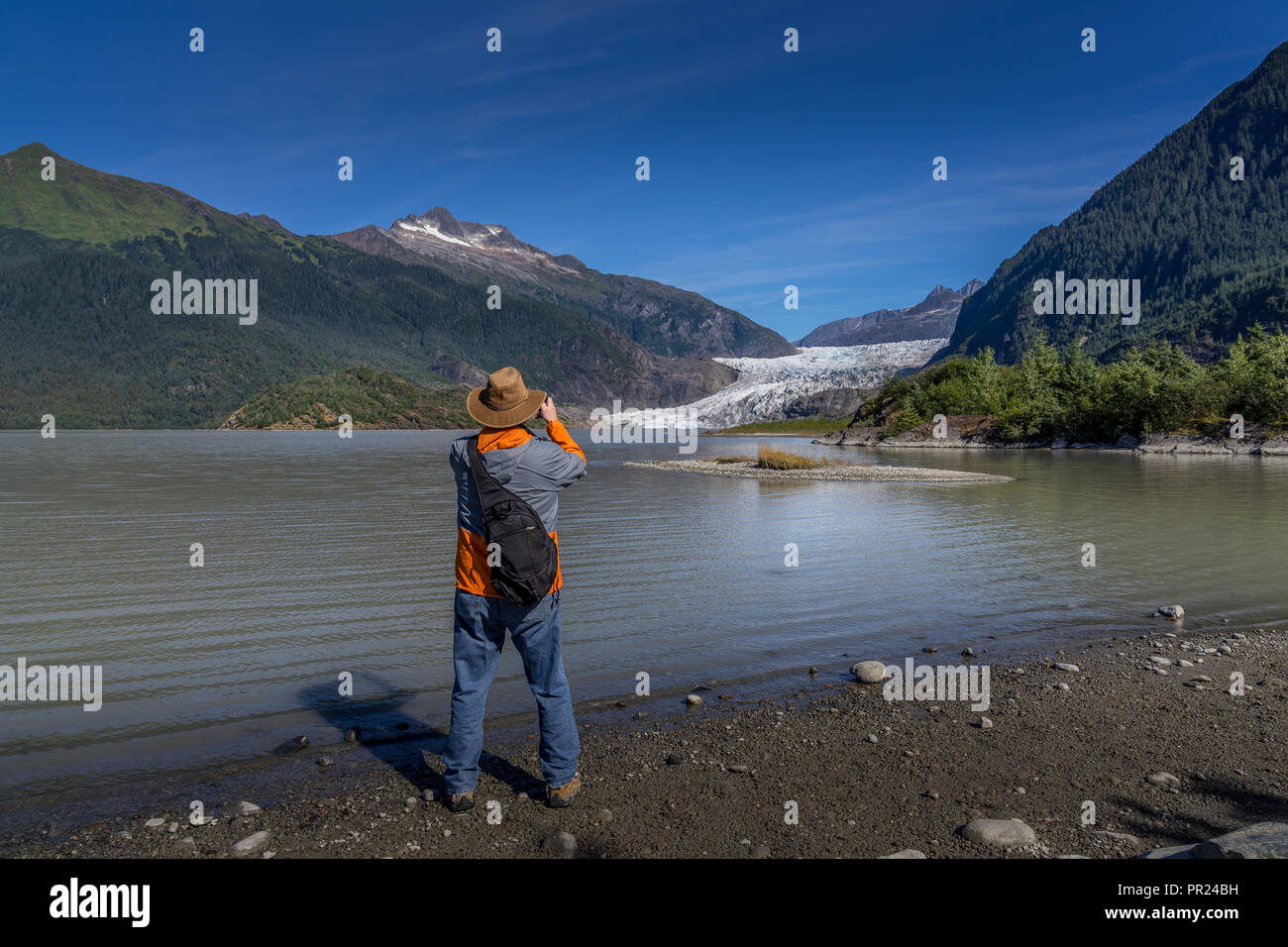 Man is photographing Mendenhall Glacier - Stock Image