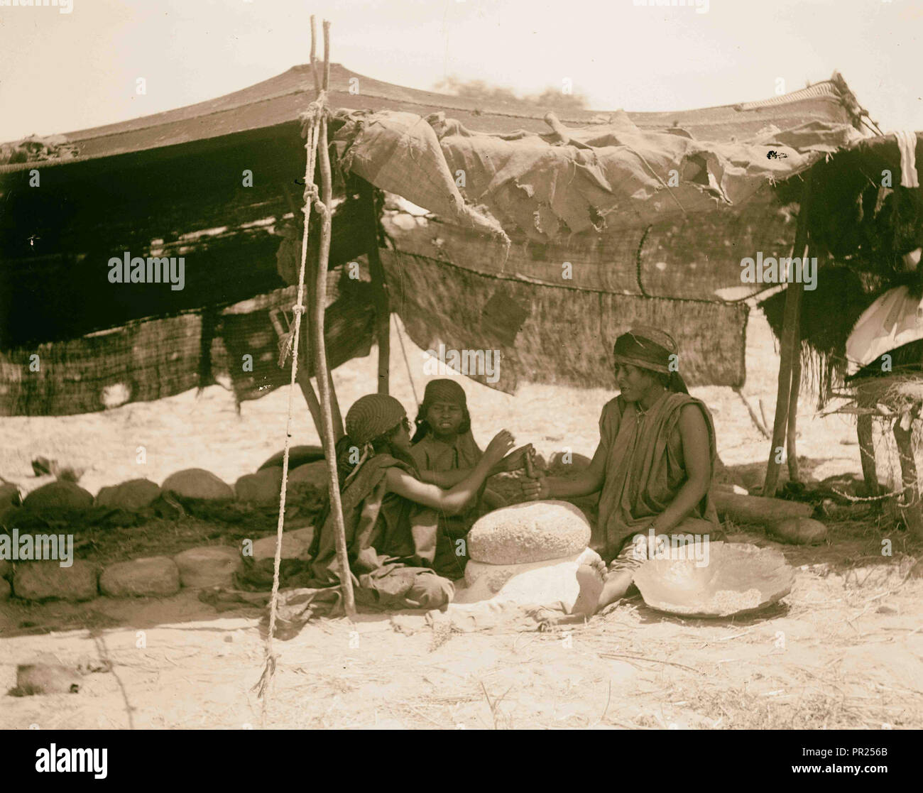 Bedouin women working primitive grainmill. 1898, Middle East, Israel and/or Palestine - Stock Image