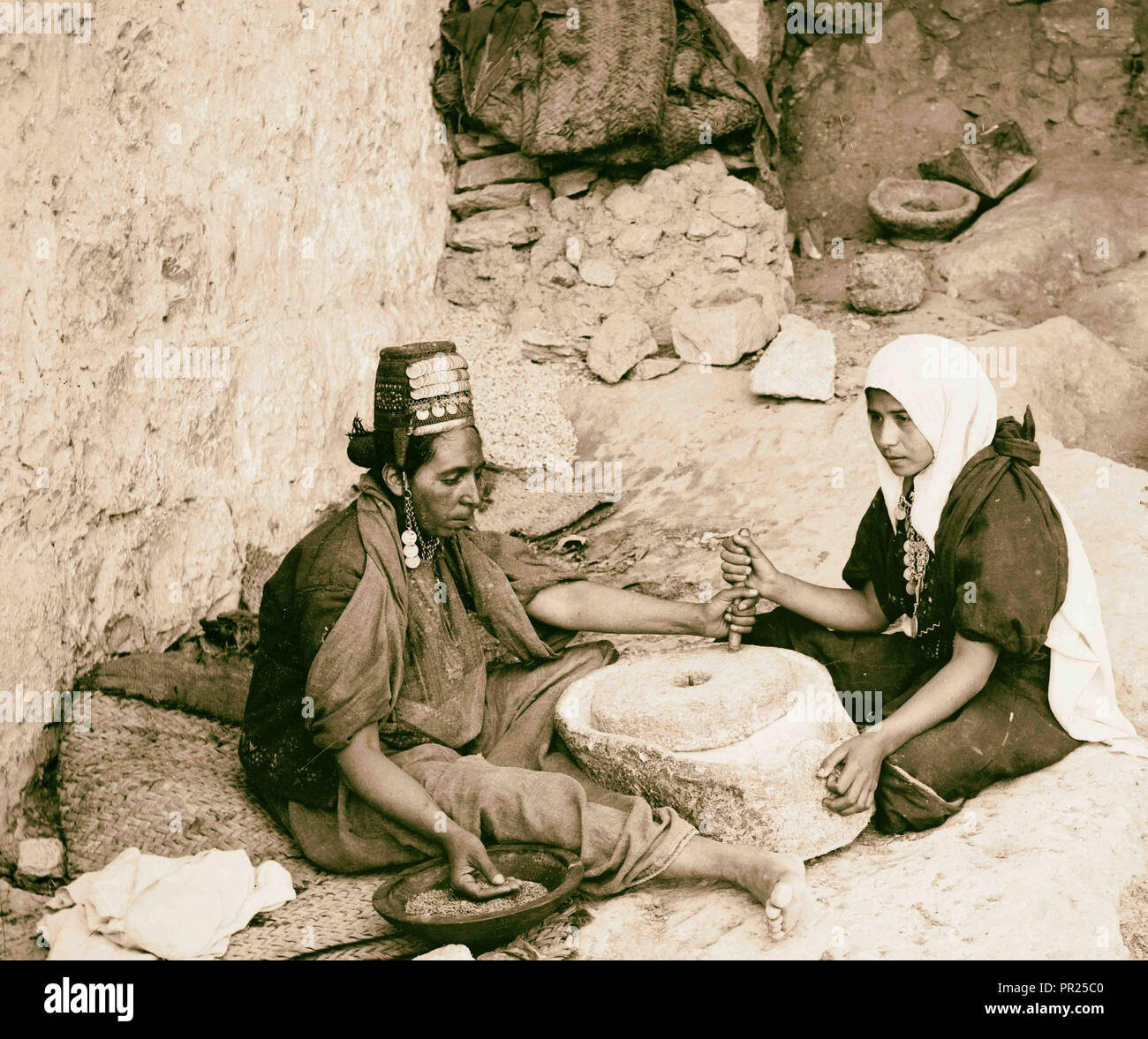 Costumes, characters and ceremonies, 'Two women at the mill'. 1898, Middle East, Israel and/or Palestine - Stock Image