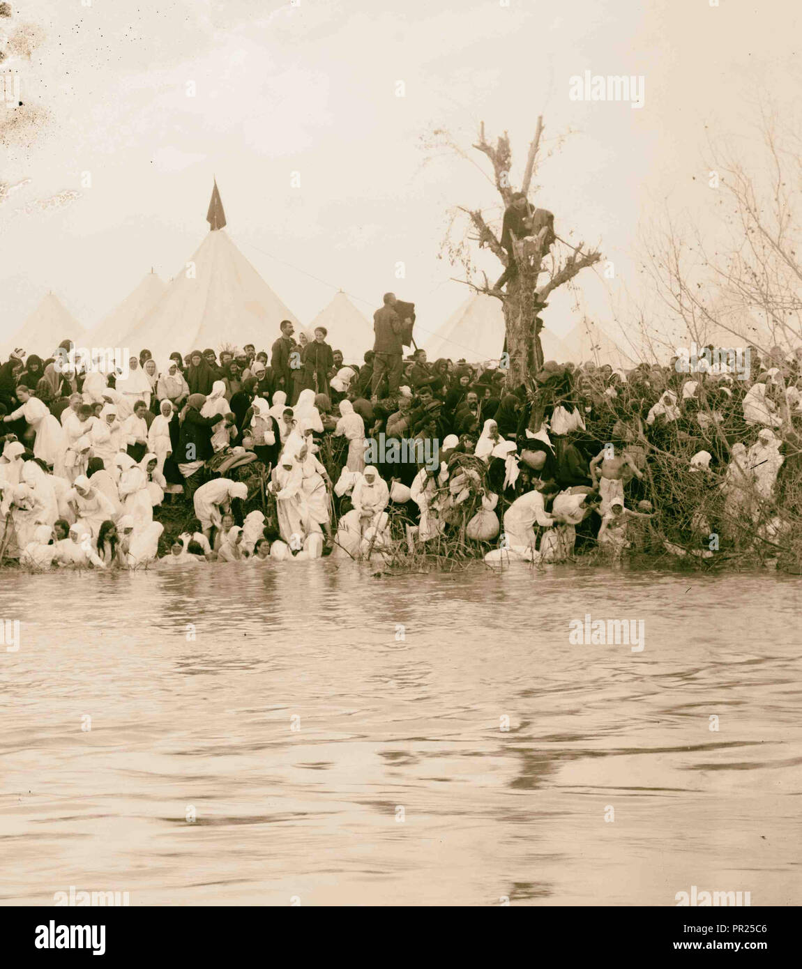 Costumes, characters and ceremonies, etc. Pilgrims immersing in the Jordan. 1898 - Stock Image