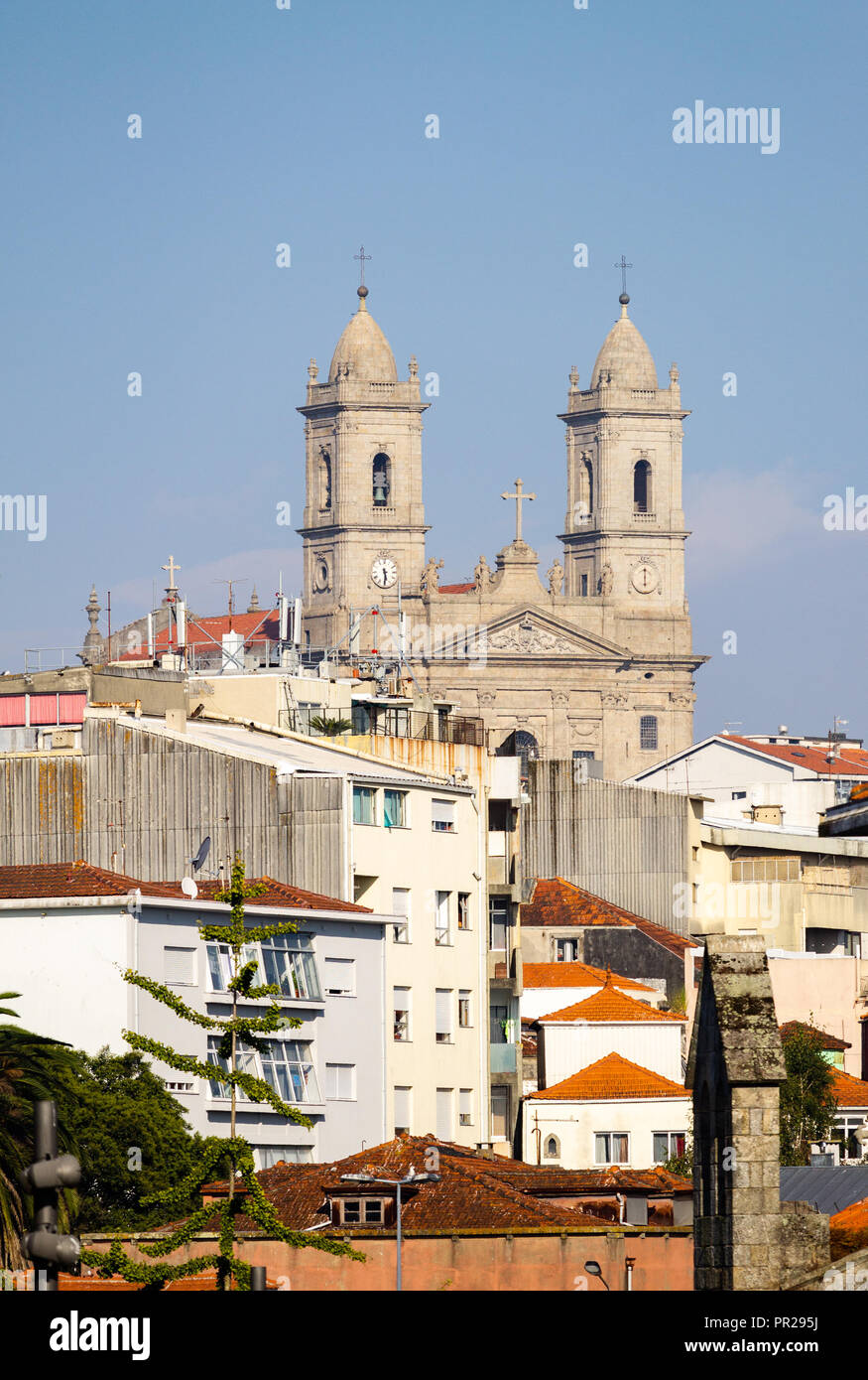 The Church of Lapa at Porto as seen from a distance, amidst various buildings. - Stock Image