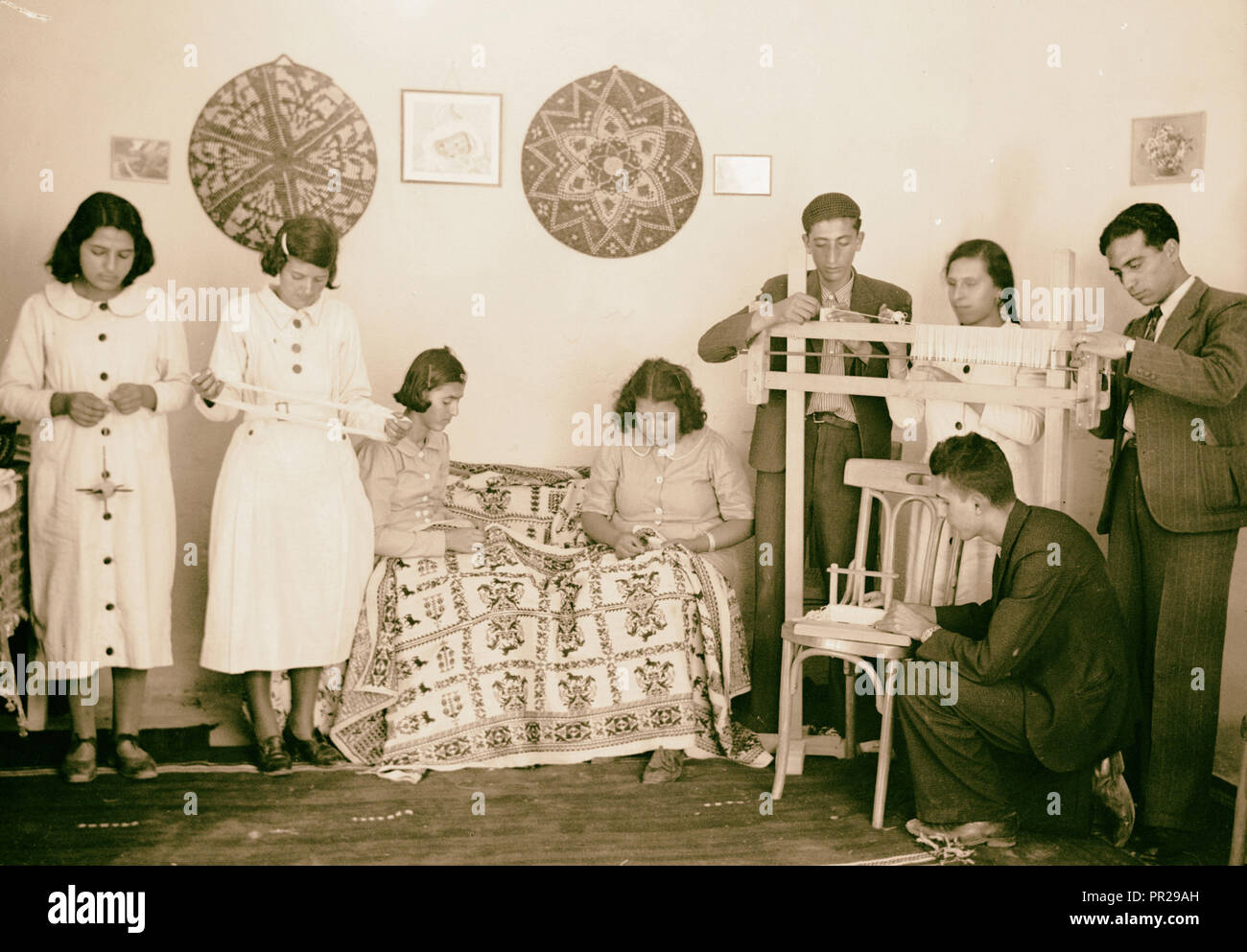 Arab Women's Union of Ramallah Another corner of the work rooms showing young people at work. 1934, West Bank, Rām Allāh - Stock Image
