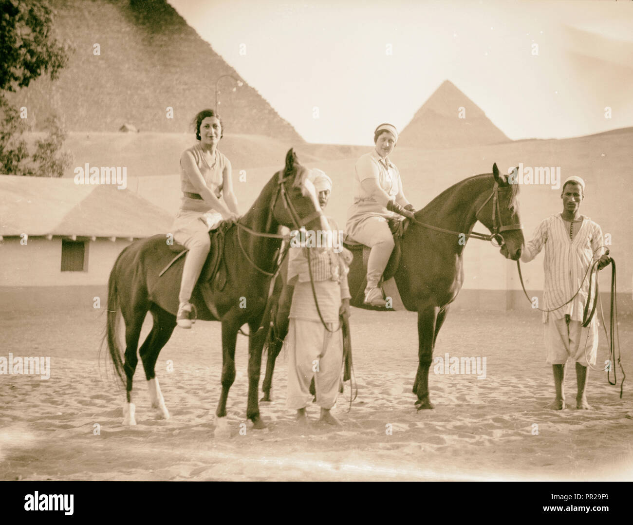 Egypt. Cairo. Hotels. Mena House. Guests riding near the Pyramids. 1934, Egypt, Cairo - Stock Image