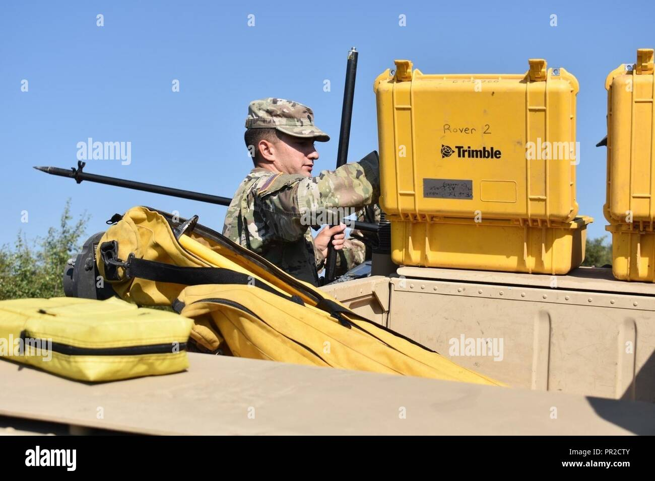 Spc  Charles Vincent prepares to assemble the mobile GNSS rovers