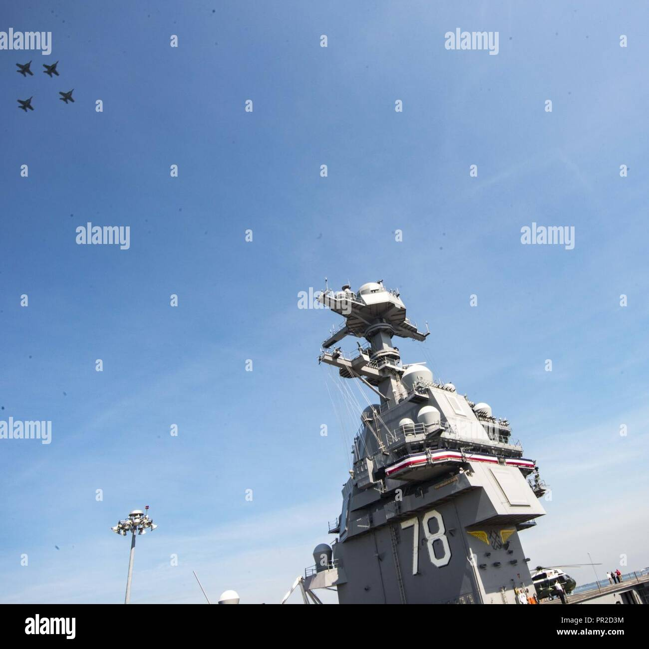 Va. (July 22, 2017) Jets conduct a fly over during the commissioning ceremony of USS Gerald R. Ford (CVN 78) at Naval Station Norfolk. Ford is the lead ship of the Ford-class aircraft carriers, and the first new U.S. aircraft carrier designed in 40 years. - Stock Image