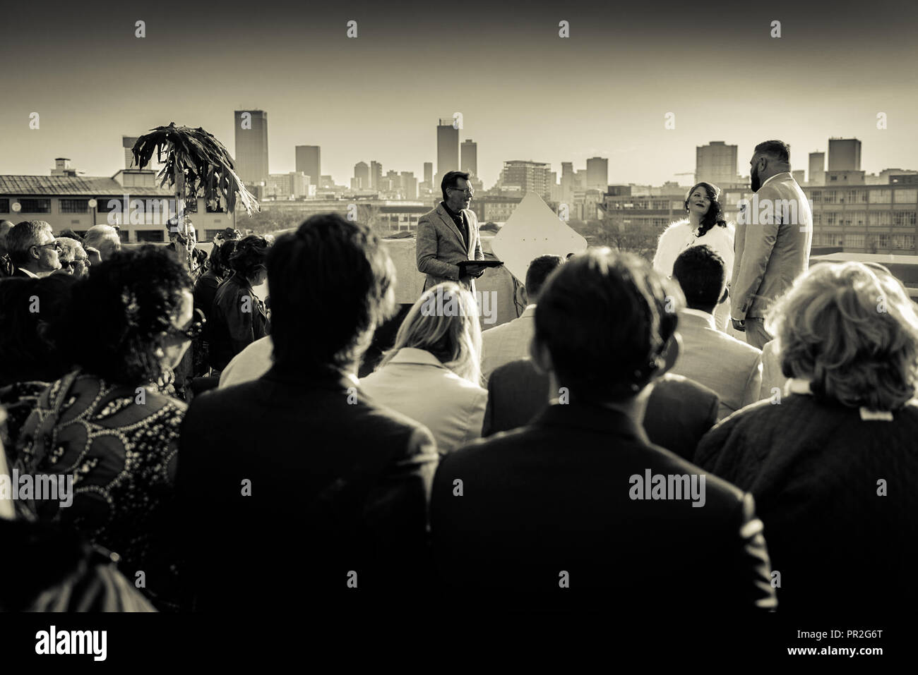 A bride and groom take their wedding vows on the roof of the Troyeville Hotel, in east Johannesburg, South Africa Stock Photo