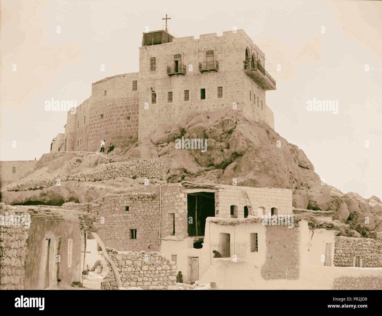 Deir Seidnaya showing the convent picturesquely perched on a cliff. 1920, Syria - Stock Image