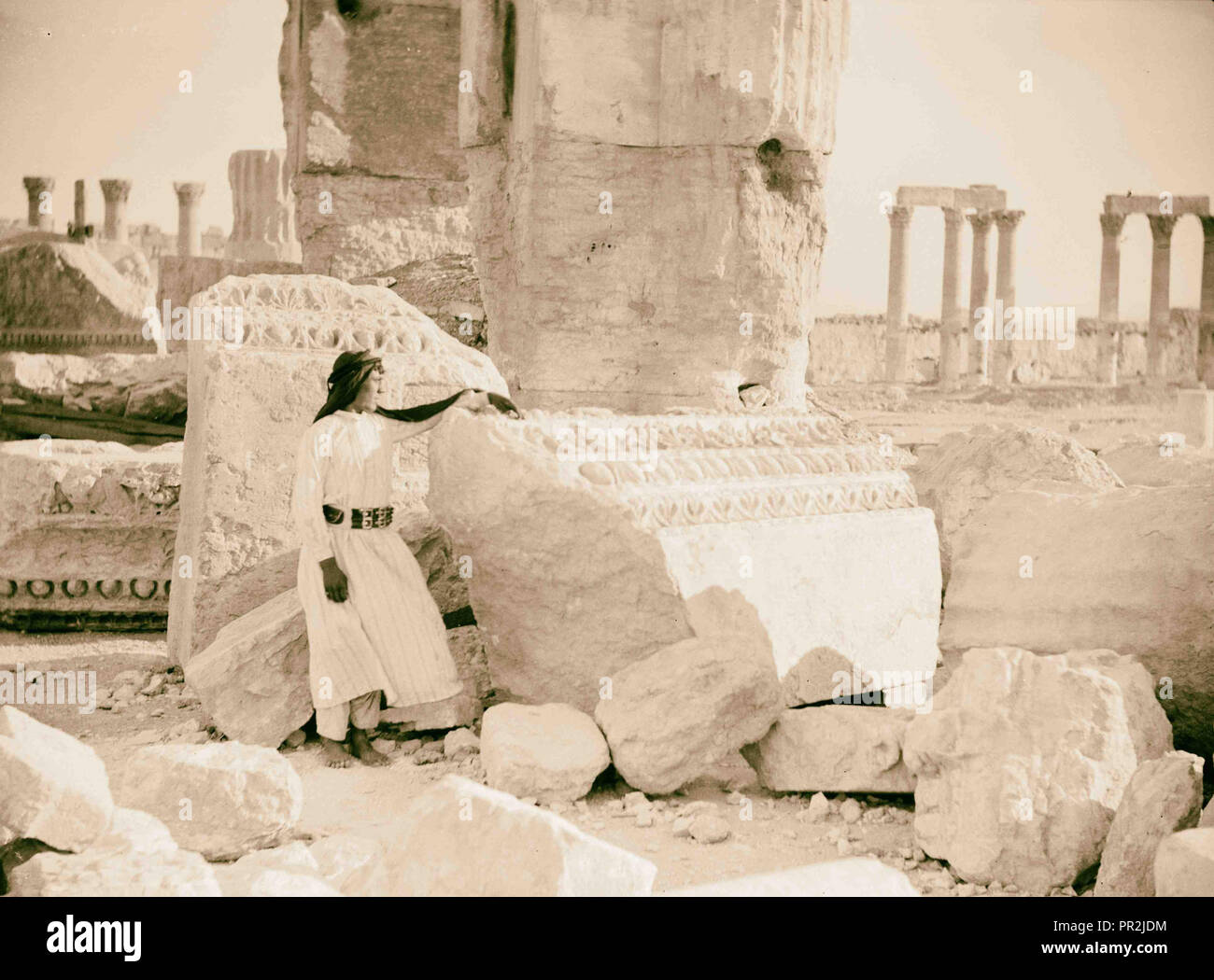 Palmyra. Temple of Baal. Fragments of the entablature, etc., at the main entrance. 1920, Syria, Tadmur - Stock Image