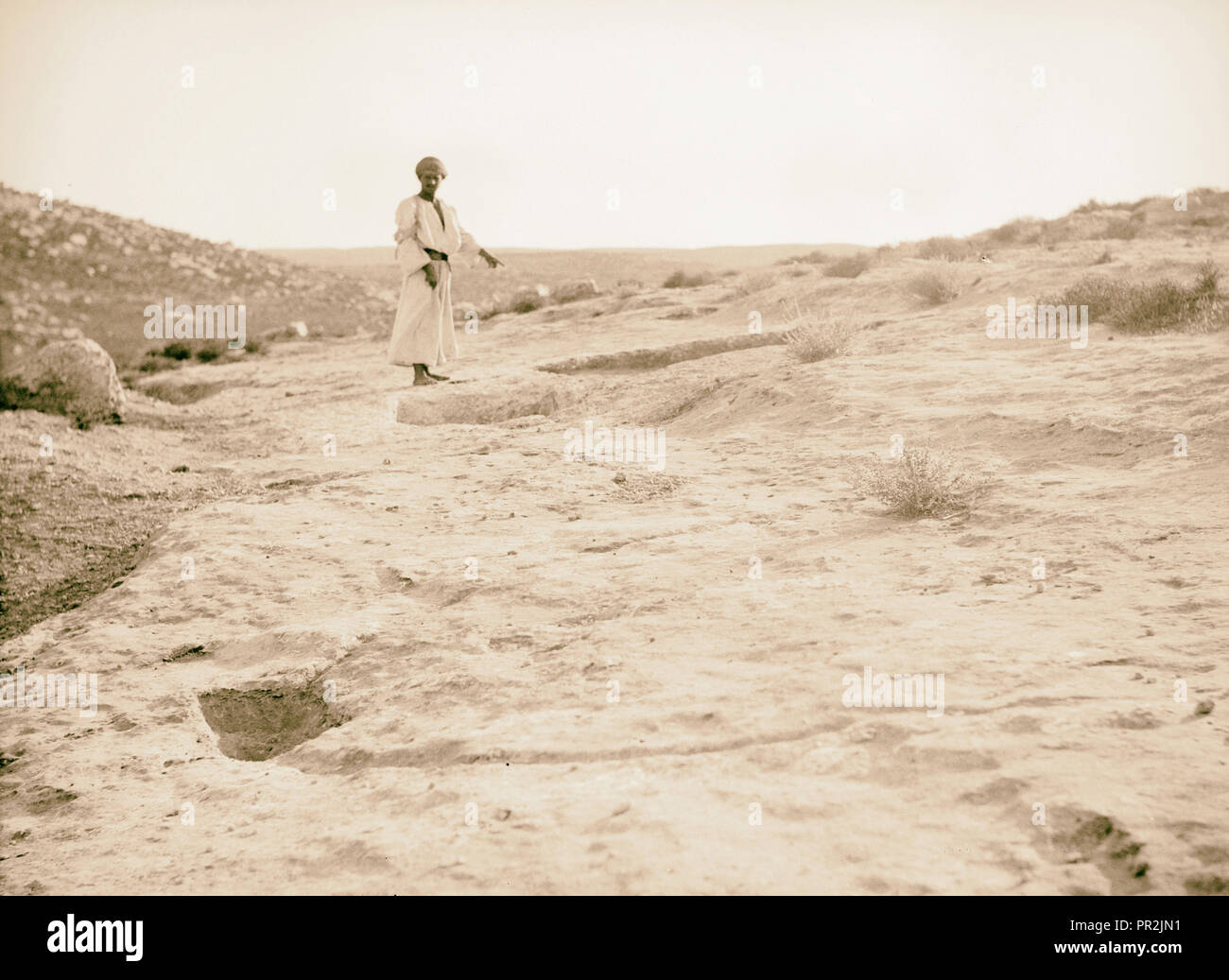 Various subjects of archaeological interest A primitive winepress. Cut in sloping rock west of Hebron road. Kilo 60-61. 1920 - Stock Image