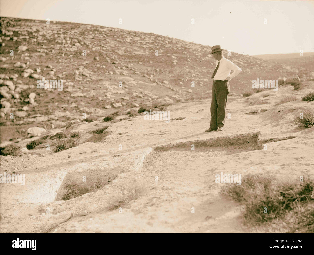 Various subjects of archaeological interest A primitive winepress showing treading-out vat. 1920, Middle East, Israel - Stock Image