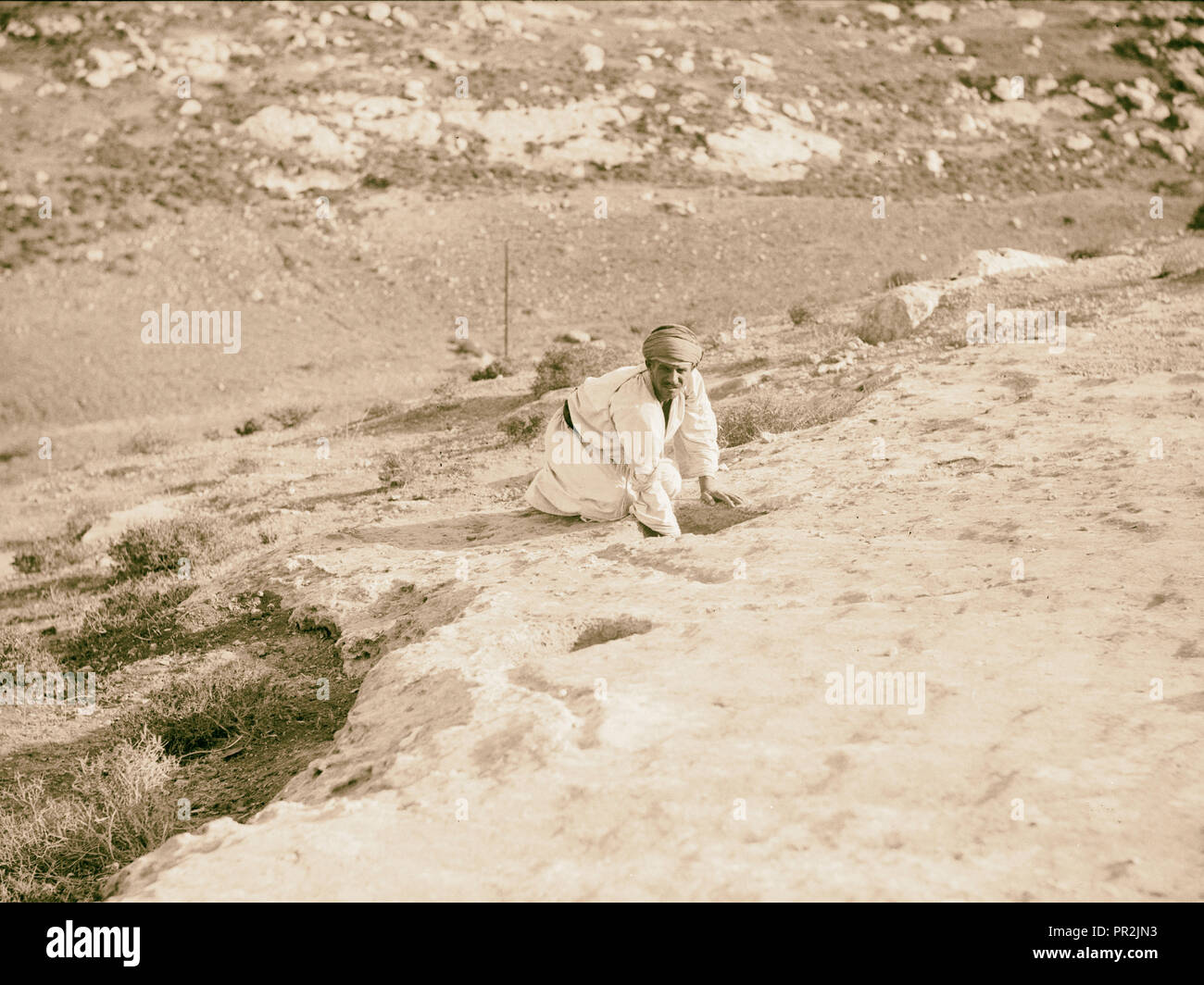 Various subjects of archaeological interest A primitive winepress showing small settling bowls. 1920, Middle East, Israel - Stock Image