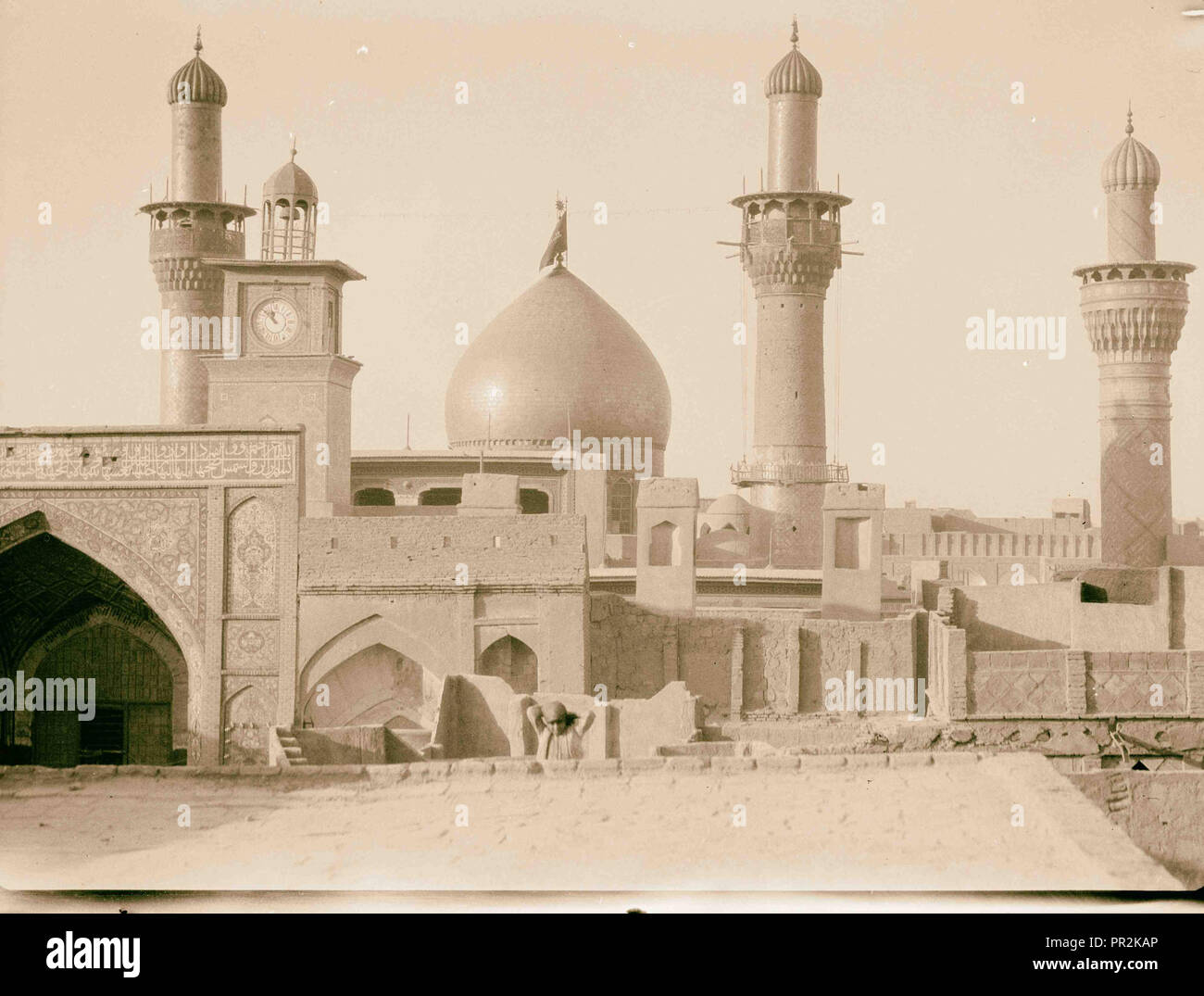 Iraq. Kerbela. Second holy city of the Shiite Moslems [i.e., Muslims]. The great mosque with dome and minarets overlaid with - Stock Image