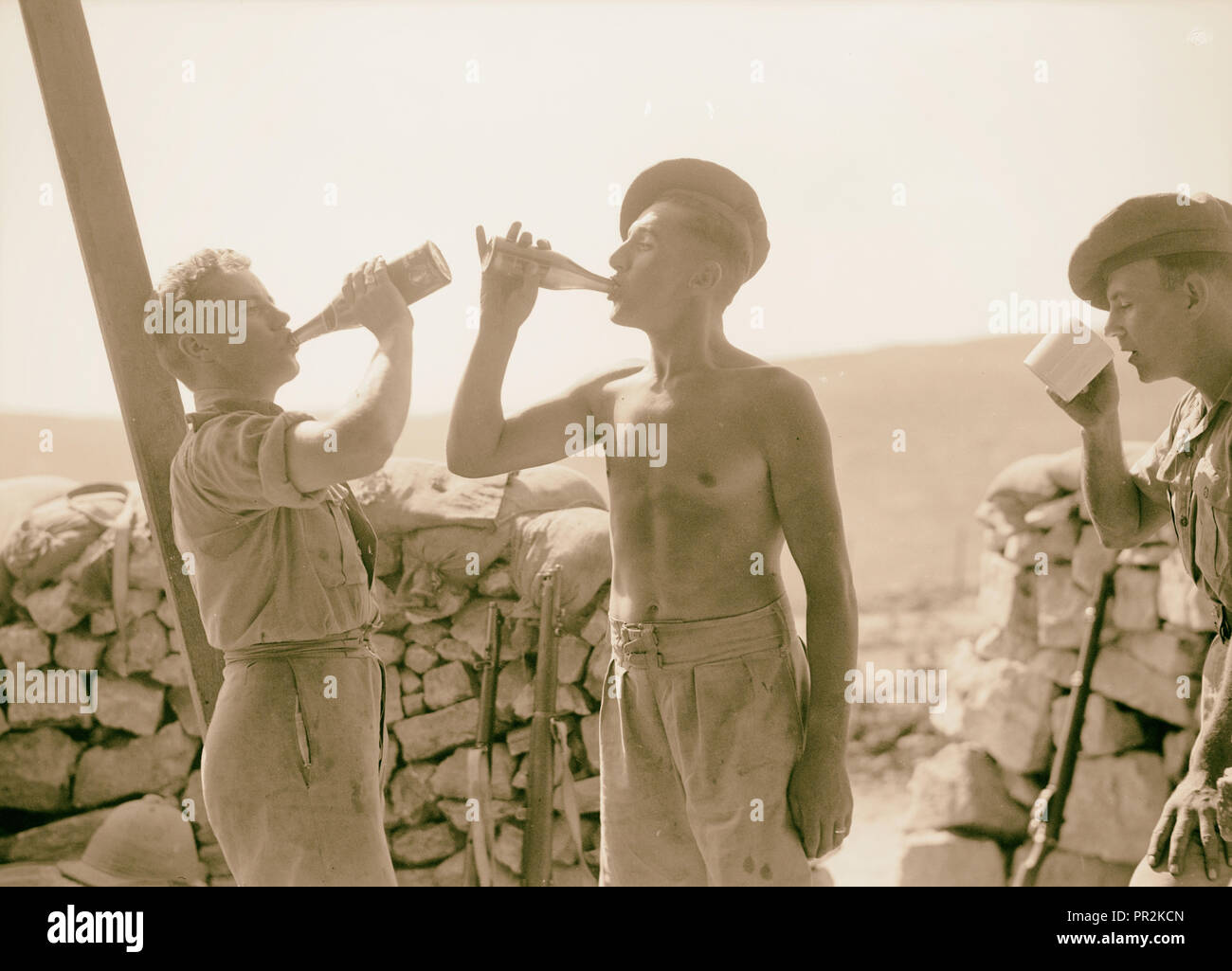 British Military Camp at klm. 41, Lubban-Nablus, Middle East Rd. British Tommies well earned bottle of beer in the Lubban Camp - Stock Image
