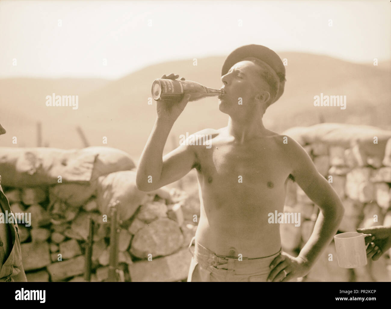 British Military Camp at klm. 41, Lubban-Nablus, Middle East Rd. British Tommies well earned bottle of beer in the Lubban Camp Stock Photo