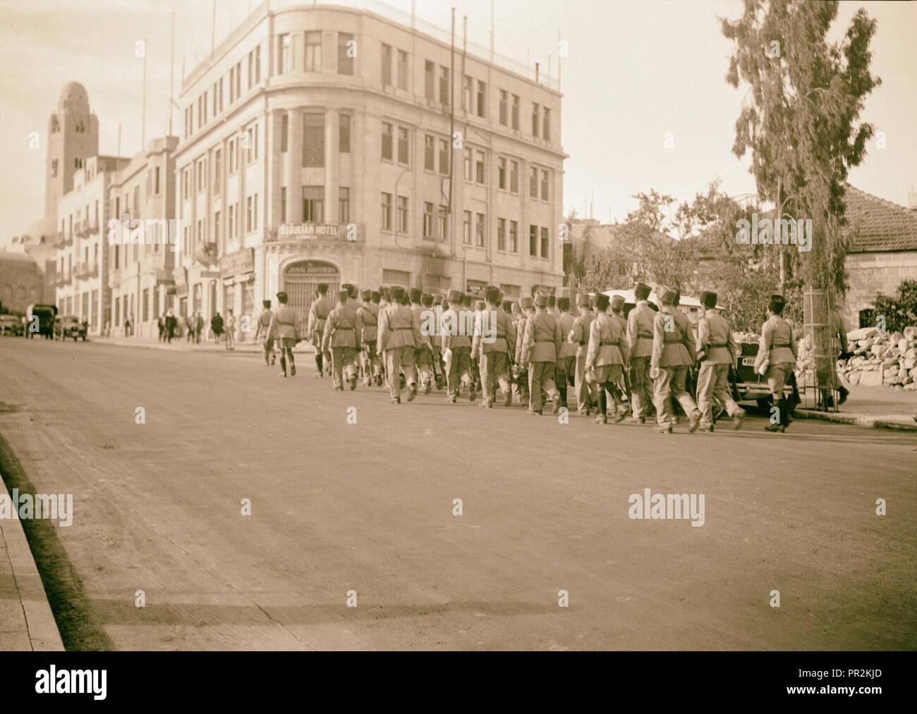 Jewish Supernumerary Police, line of about 50 men marching on Julian Way, Nov. 5, 1938, Jerusalem, Israel - Stock Image