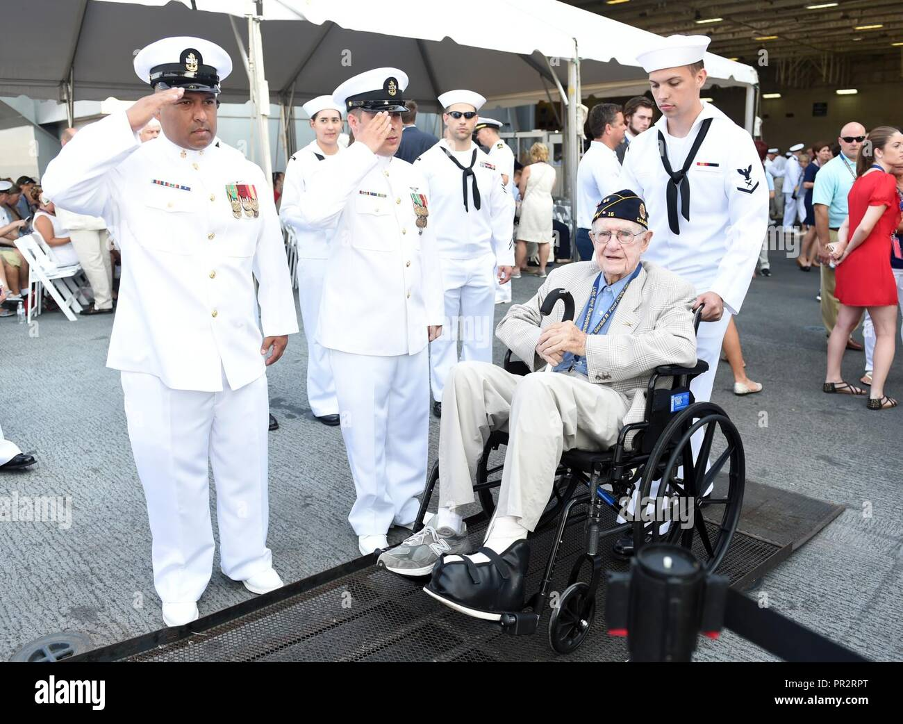 (July 22, 2017) Sailors welcome a veteran aboard to enjoy the aircraft carrierUSS Gerald R. Ford's (CVN 78) commissioning ceremony at Naval Station Norfolk, Va. Ford is the lead ship of the Ford-class aircraft carriers, and the first new U.S. aircraft carrier design in 40 years. - Stock Image