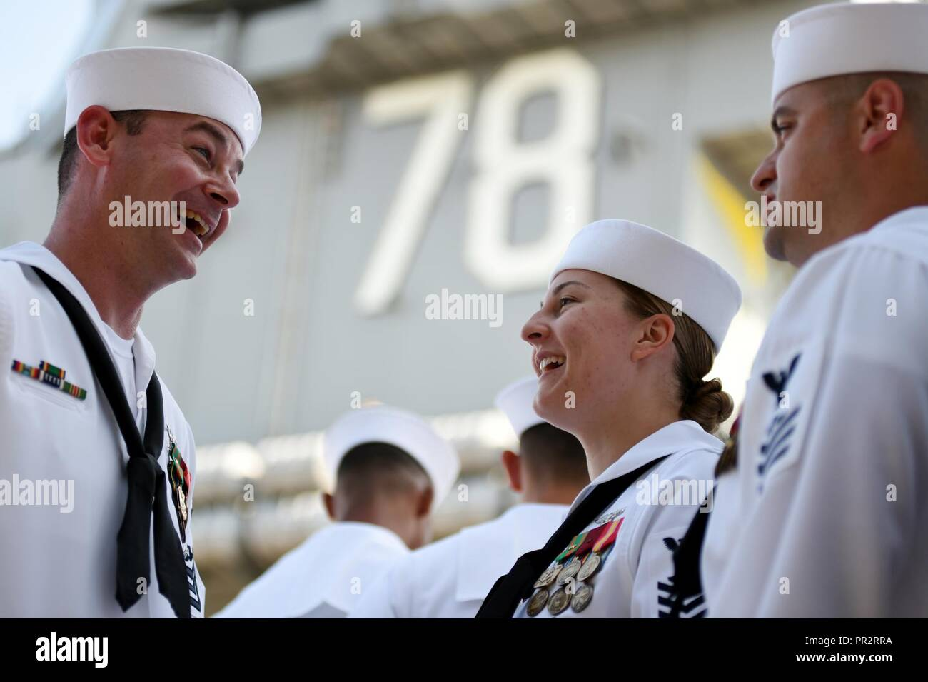 e8301e09 (July 22, 2017) Sailors talk before the aircraft carrier USS Gerald R.  Ford's (CVN 78) commissioning ...