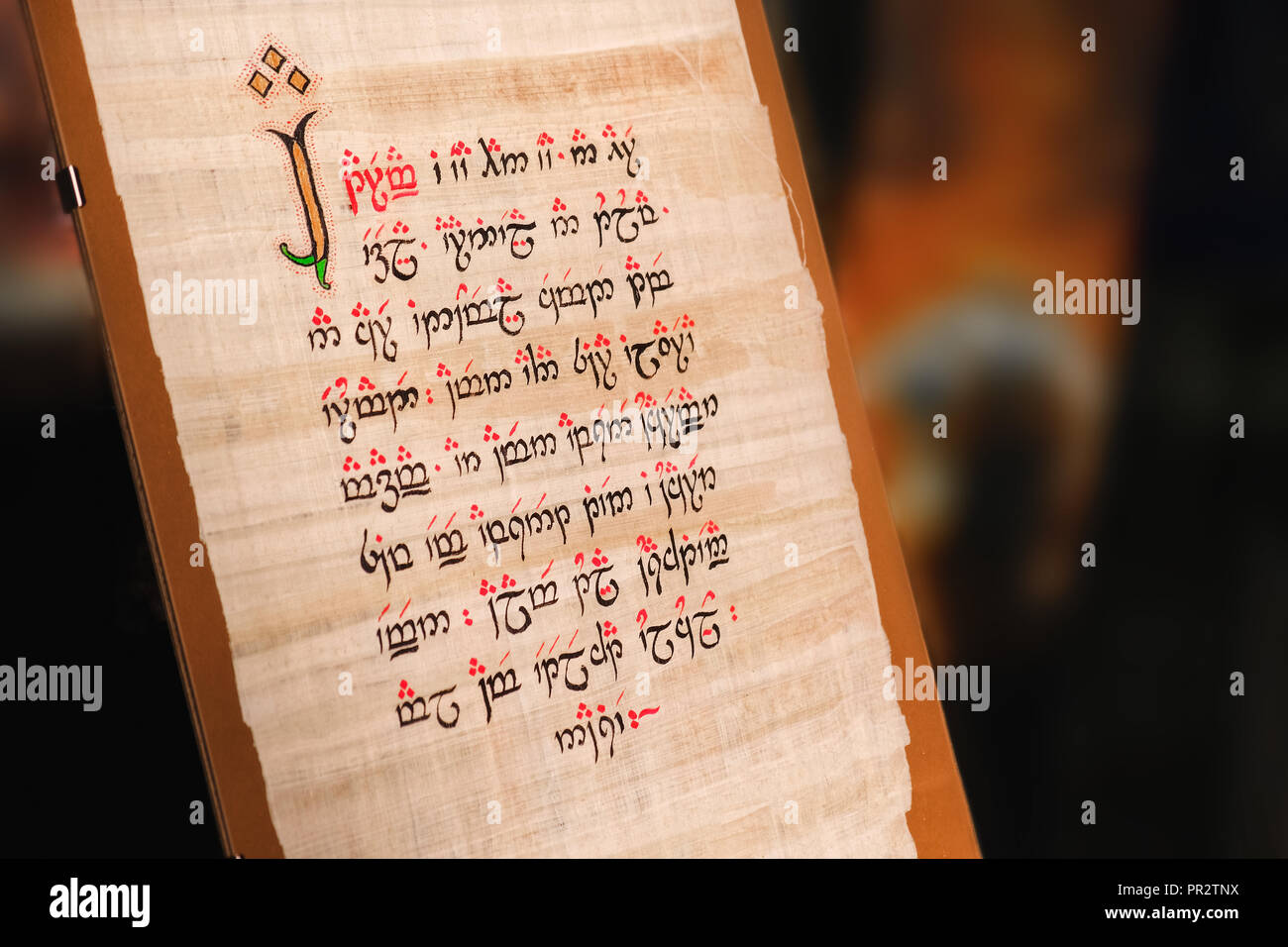 elvish manuscript text written on silk parchment created by Tolkien - Stock Image