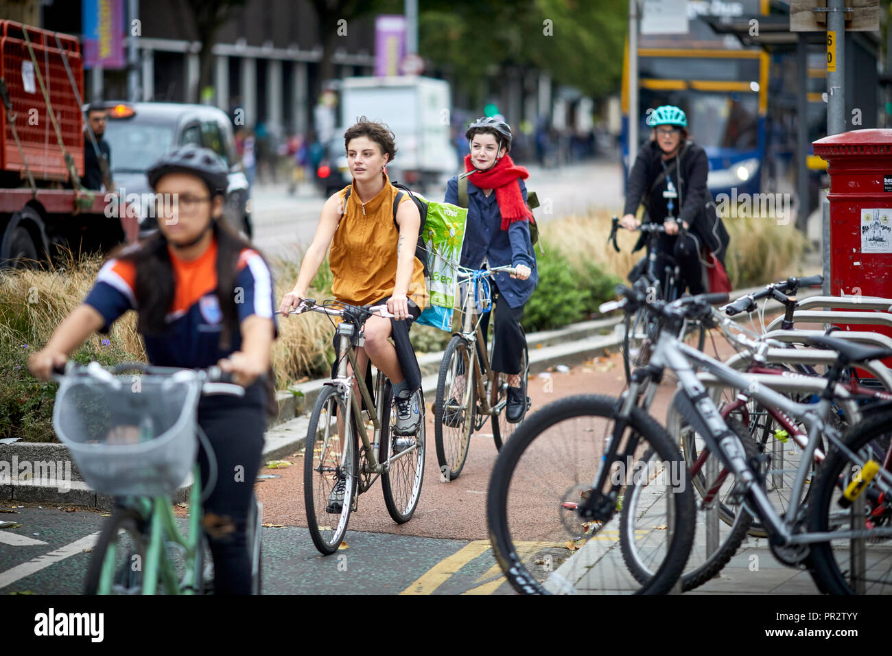 Manchester Oxford Road cycle lane and bus lane passing the University. - Stock Image