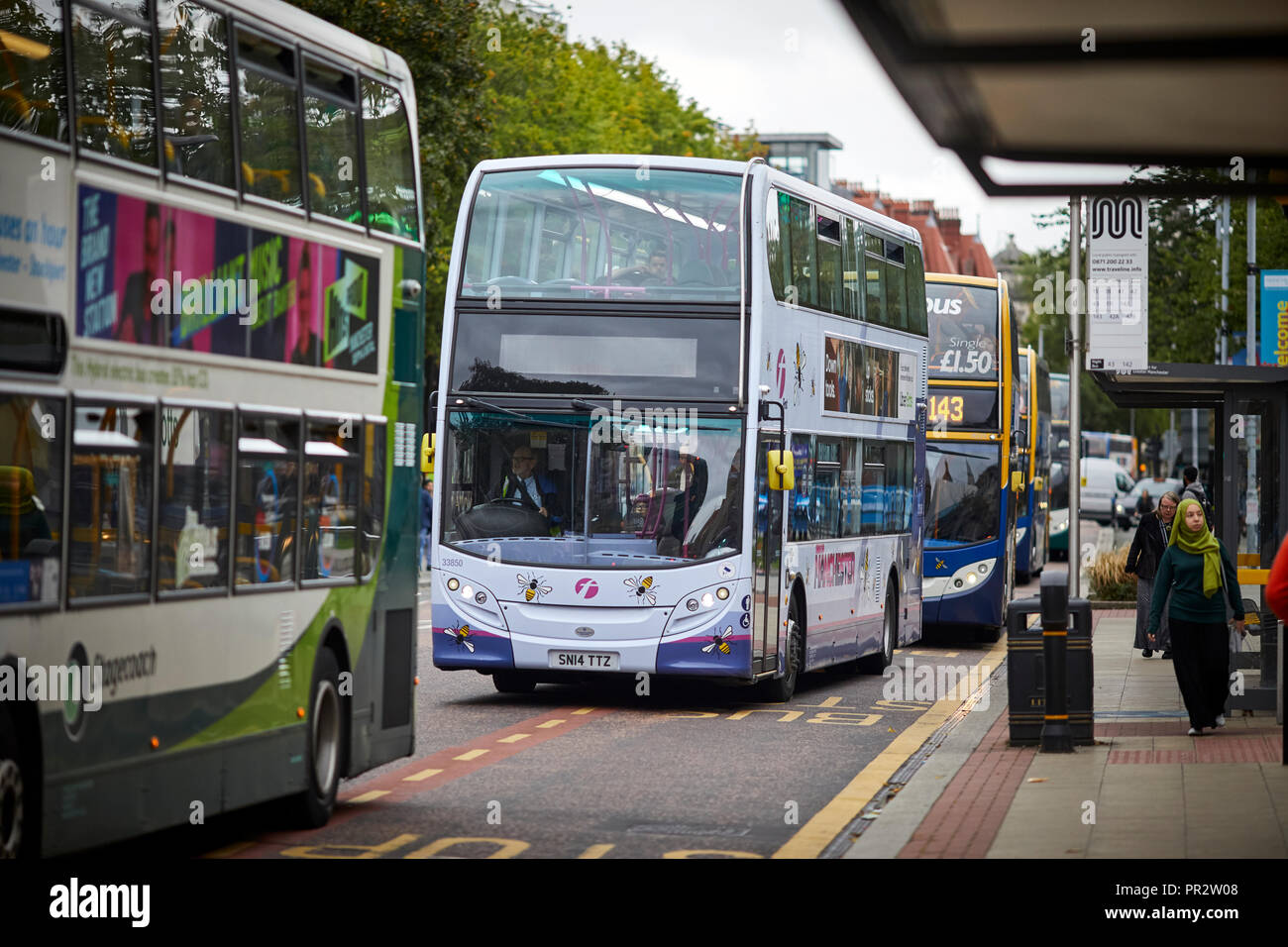 Manchester Oxford Road cycle lane and bus lane passing the University. The busiest bus corridor in Europe. - Stock Image