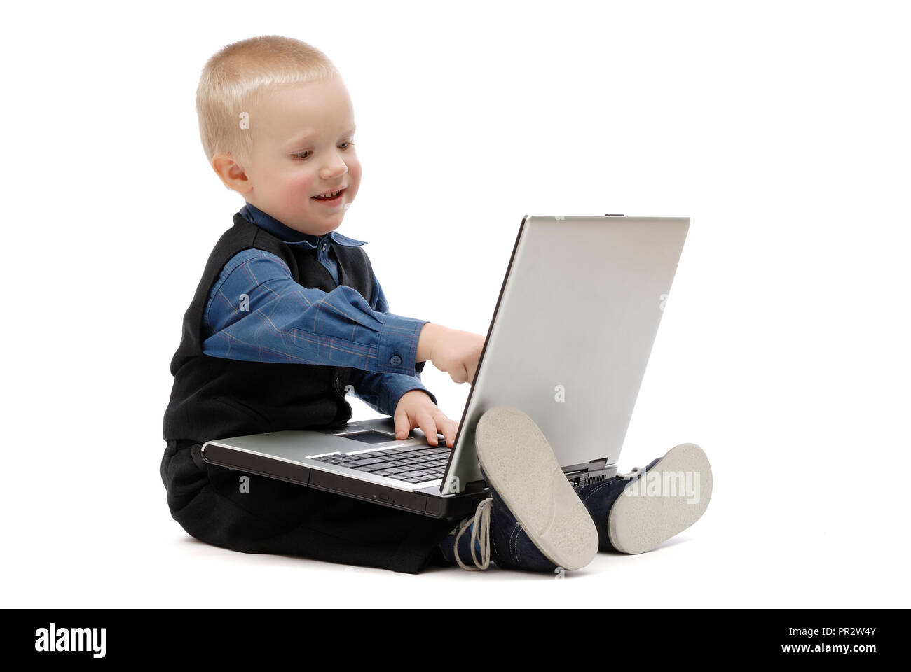 Little boy with a laptop on white background, isolated - Stock Image