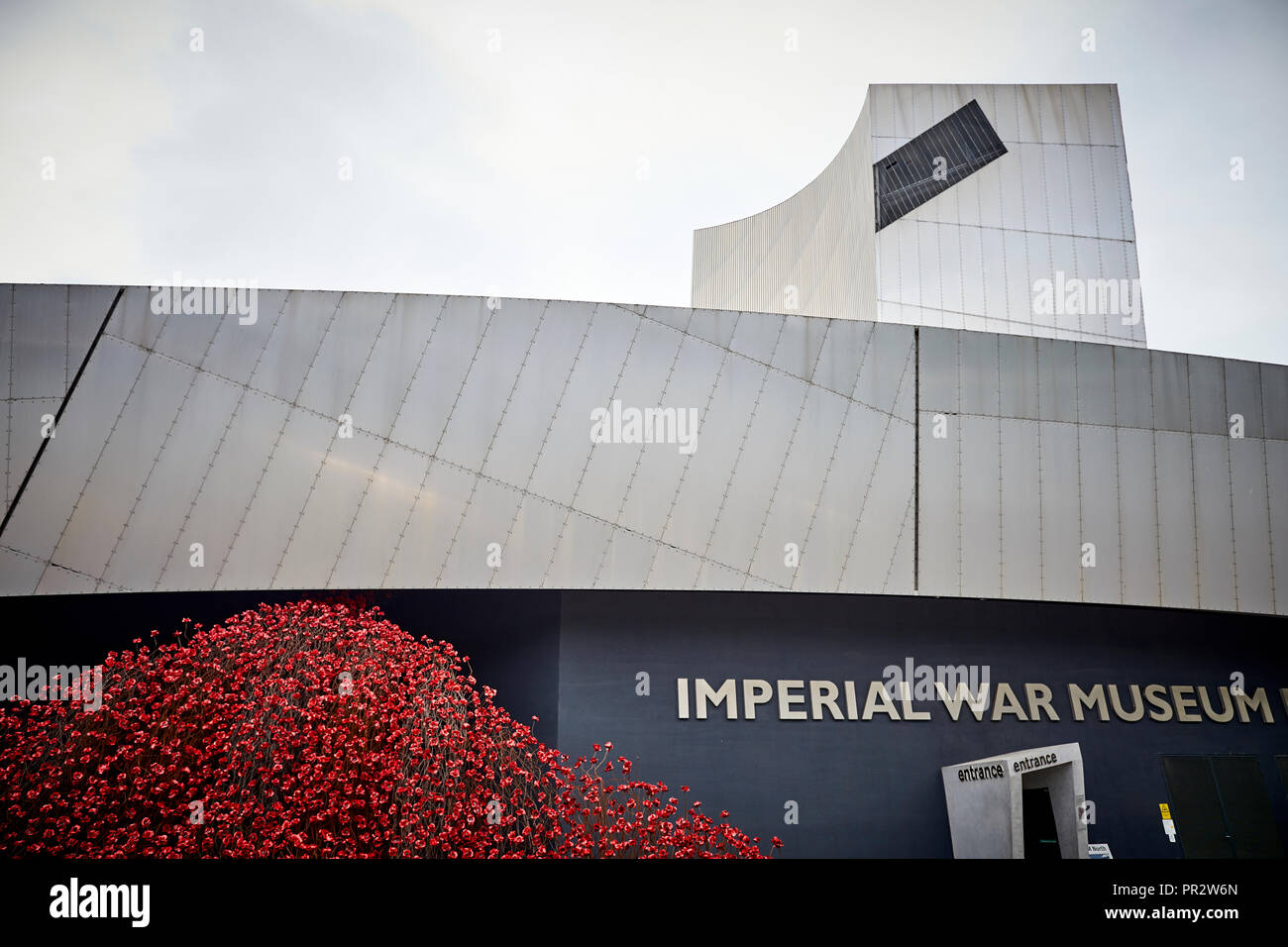 IWMN Wave cascade several thousand handmade ceramic poppies sculptures by artist Paul Cummins and designer Tom Piper at  Imperial War Museum North - Stock Image