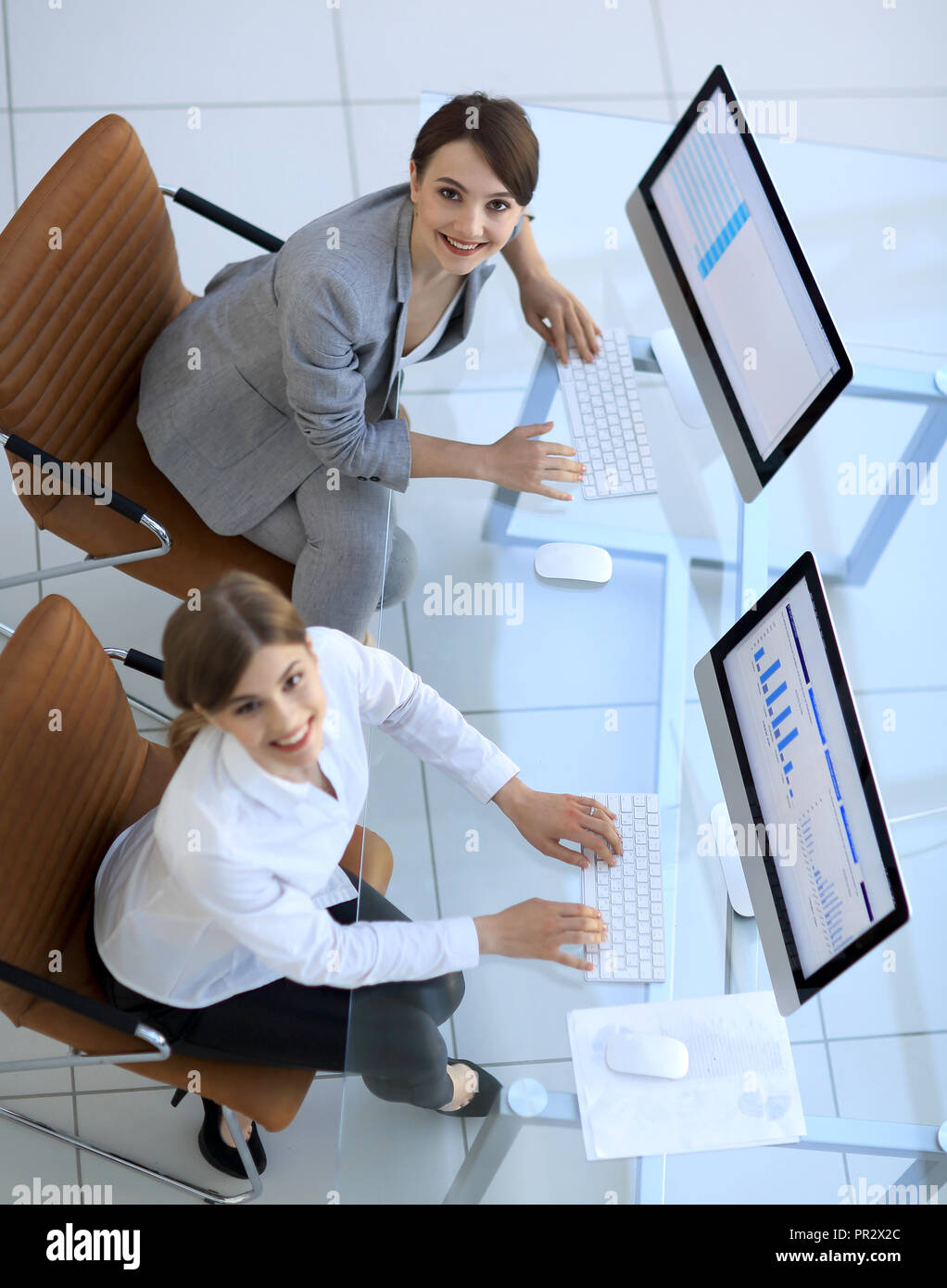 staff of the planning Department sitting behind a Desk and looking at camera. - Stock Image