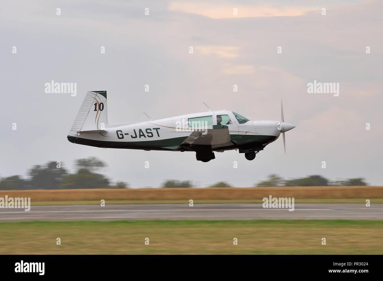 Mooney Aircraft Corporation Mooney M20J G-JAST 'Race 10' taking off for Royal Aero Club Air Race at Sywell Aerodrome. Michael Willis pilot - Stock Image