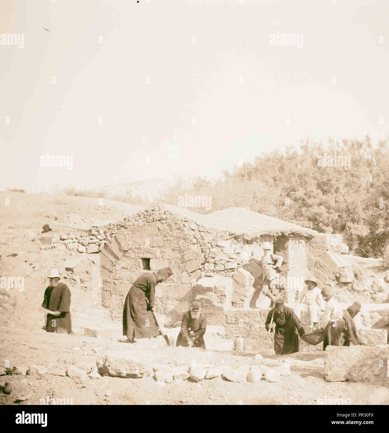 People including Greek monks? excavating around structure American Colony, Jerusalem. 1898, Israel - Stock Image