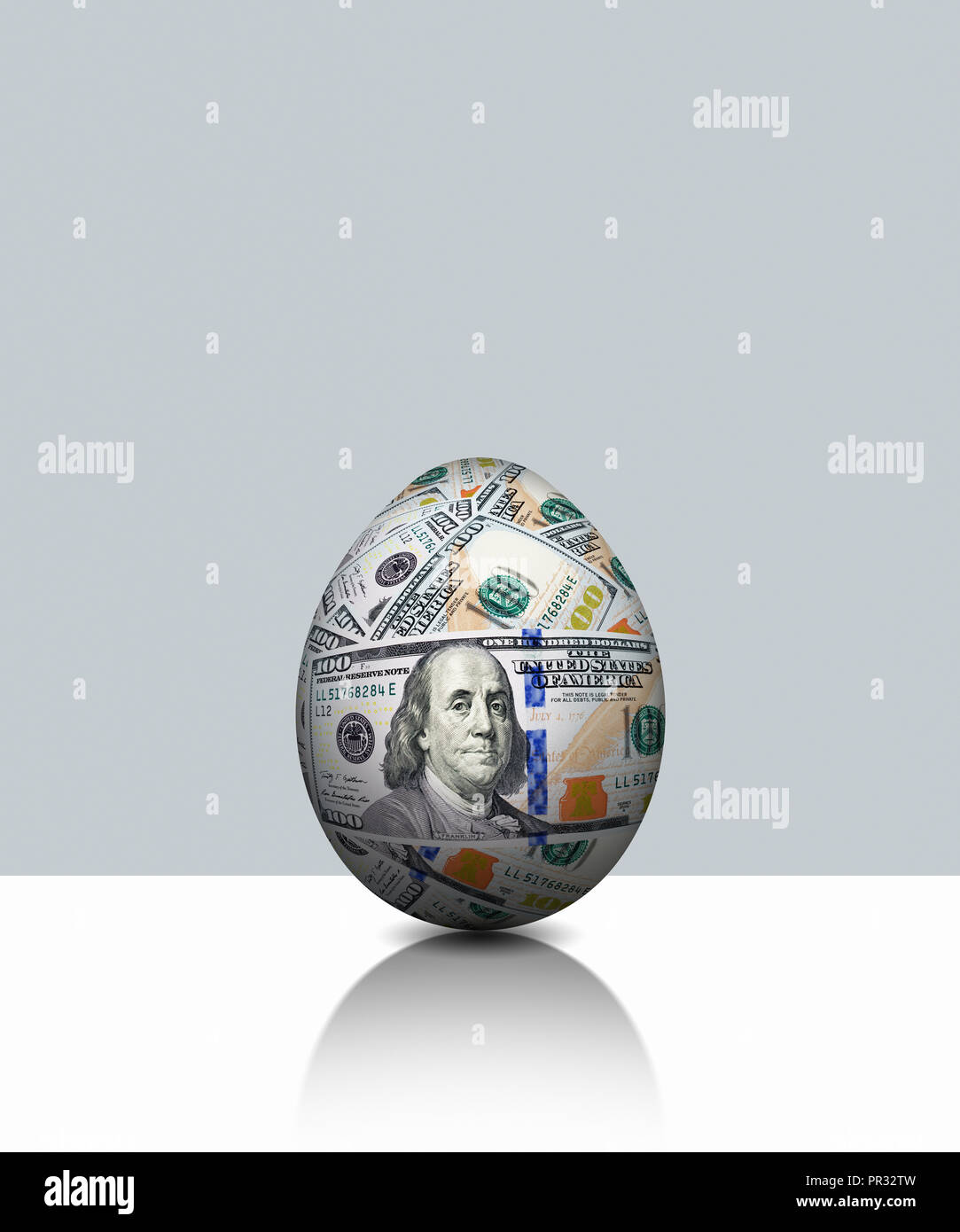 Global Currency, Egg Made from US USD $100 Hundred Dollar - Stock Image