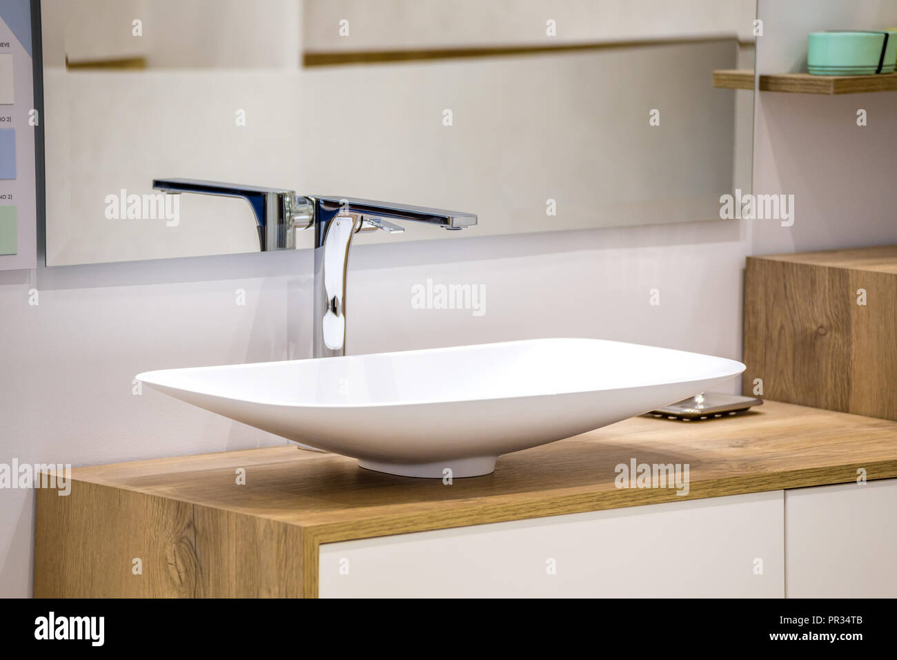 Chrome Faucet And White Sink On Wooden Vanity Top Stock Photo Alamy
