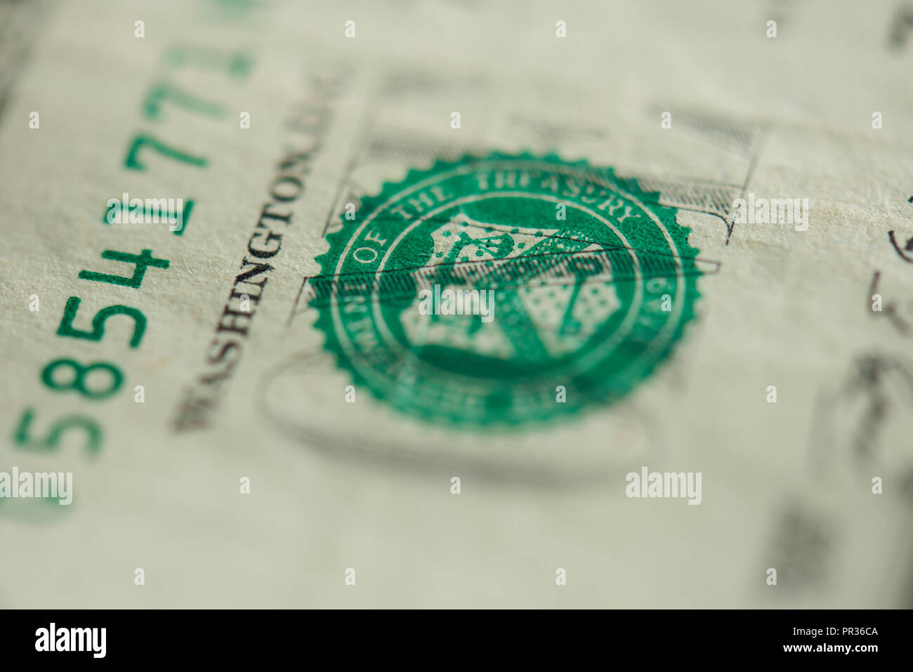 Green Stamp On One Dollar Bill Close Up View