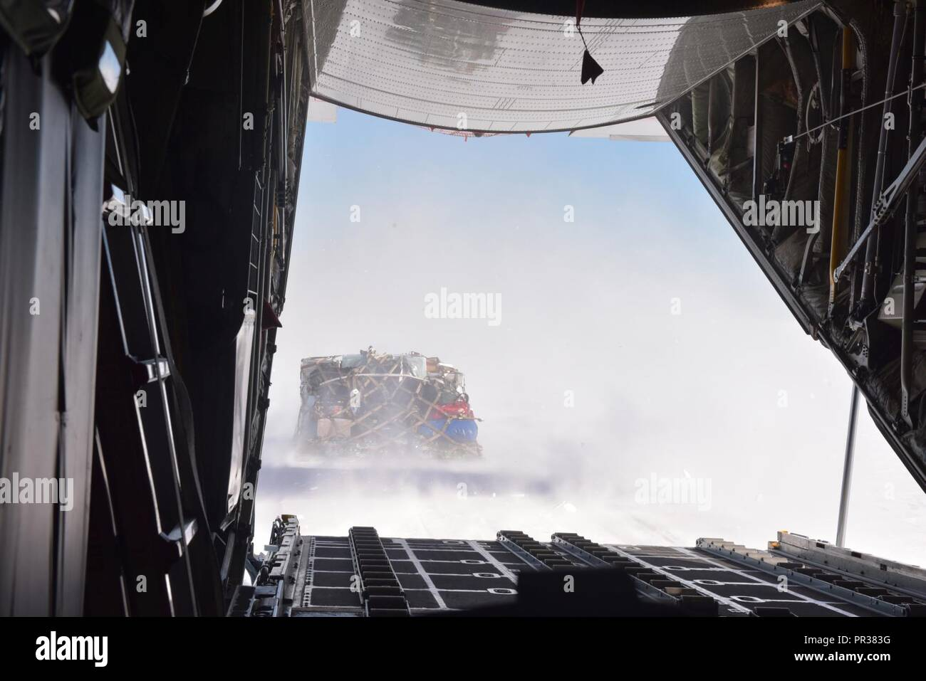 Air Force aircrews assigned to the New York Air National Guard's 109th Airlift Wing conduct a combat offload of cargo off a 109th Airlift Wing LC-130 Skibird transported to the East Greenland Ice Core Project (GRIP) July 29, 2017. That was the 13th mission the 109th Airlift Wing made to East GRIP this season to transport cargo and scientists. The 109th Airlift Wing is uniquely equipped to make landings on snow and ice in support of National Science Foundation research in Greenland. U.S. Air National Guard - Stock Image