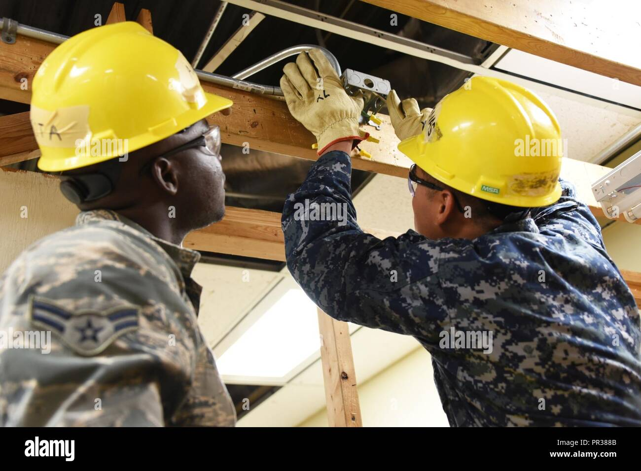 Airman Henneh Kota And Seaman Salvador Cardenas Andrade 366th Electrical Wiring Course Training Squadron Systems Students Perform The Of A Junction Box At