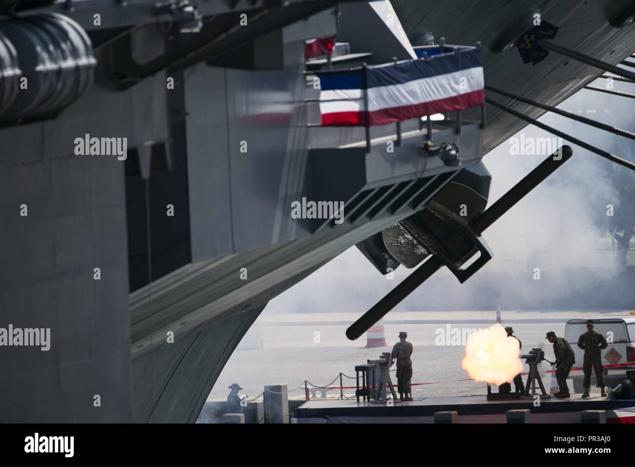 NORFOLK, Va. (July 22, 2017) -- Marines fire off a 21-gun salute to give honors to President Donald J. Trump during Ford's commissioning ceremony. Ford is the lead ship of the Ford-class aircraft carriers, and the first new U.S. aircraft carrier design in 40 years. - Stock Image