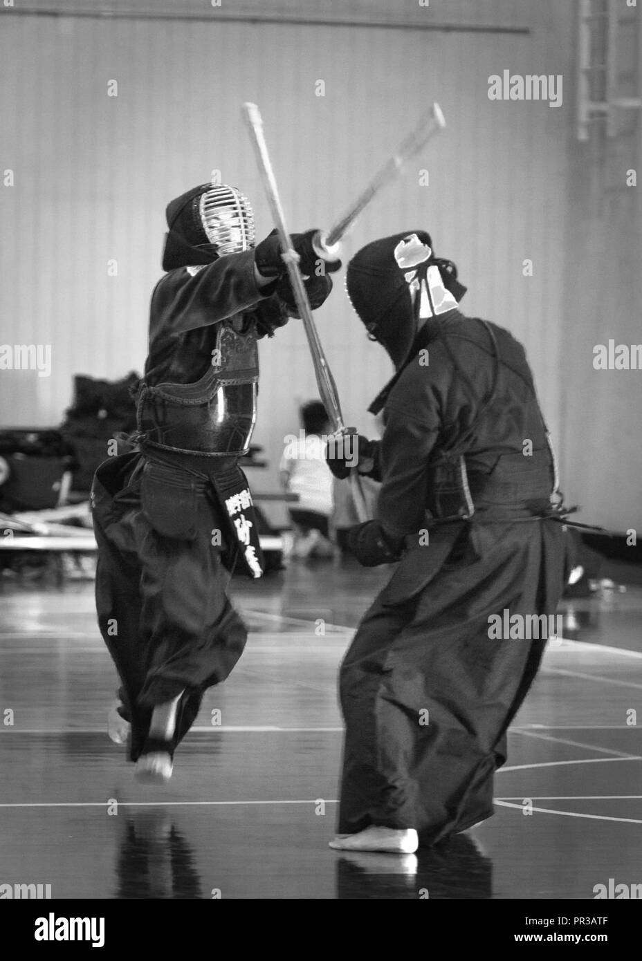 A kendo practitioner strikes his opponent's head during the Kendo Club Joint Summer Camp at Yokota Air Base, Japan, July 29, 2017. Yokota Kendo Club has practiced every Saturday for about 25 years. Kazuto Miura, headmaster of Keitenkan Dojo in Akishima city, founded Yokota Kendo Club and started to teach kendo on base. Yokota Kendo Club and Keitenkan Dojo hold summer camps together annually; this is the sixth time the summer camp has been held on base. - Stock Image