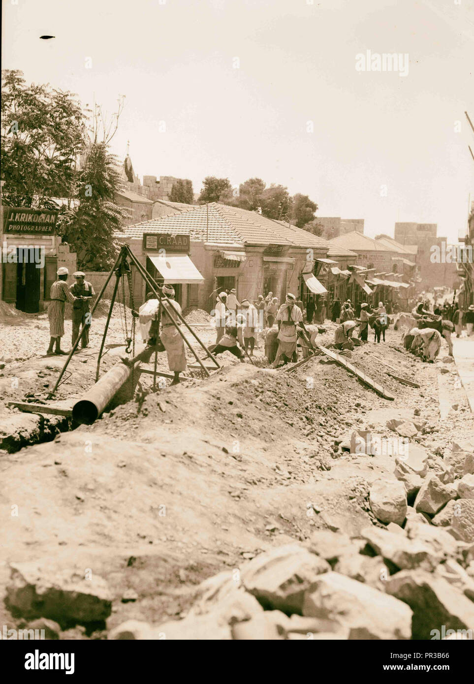 Clearing around city wall. Digging sewage canals on Jaffa Road. Photo shows the photograph studios of 'J. Krikorian' - Stock Image