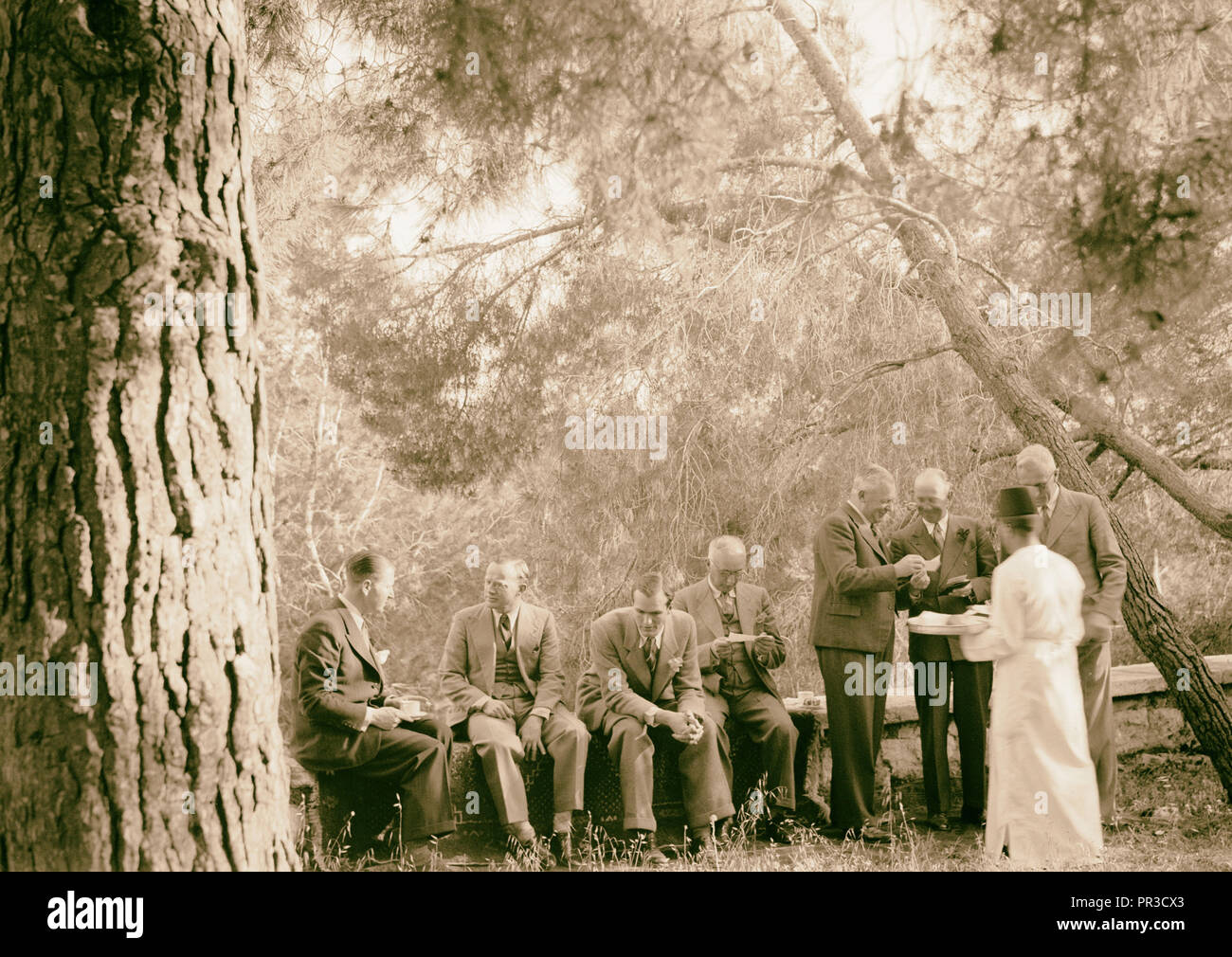 Reception by the Director of Programmes, Palestine Broadcasting Service. Tea being served. 1940 - Stock Image