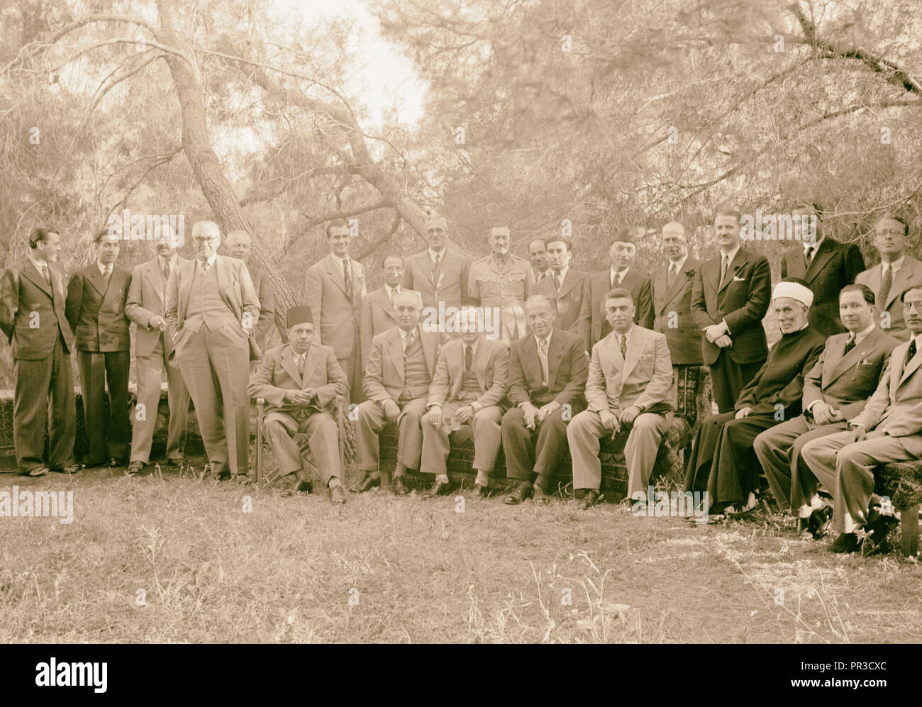 Reception by the Director of Programmes, Palestine Broadcasting Service. Groups of all the guests. 1940 - Stock Image